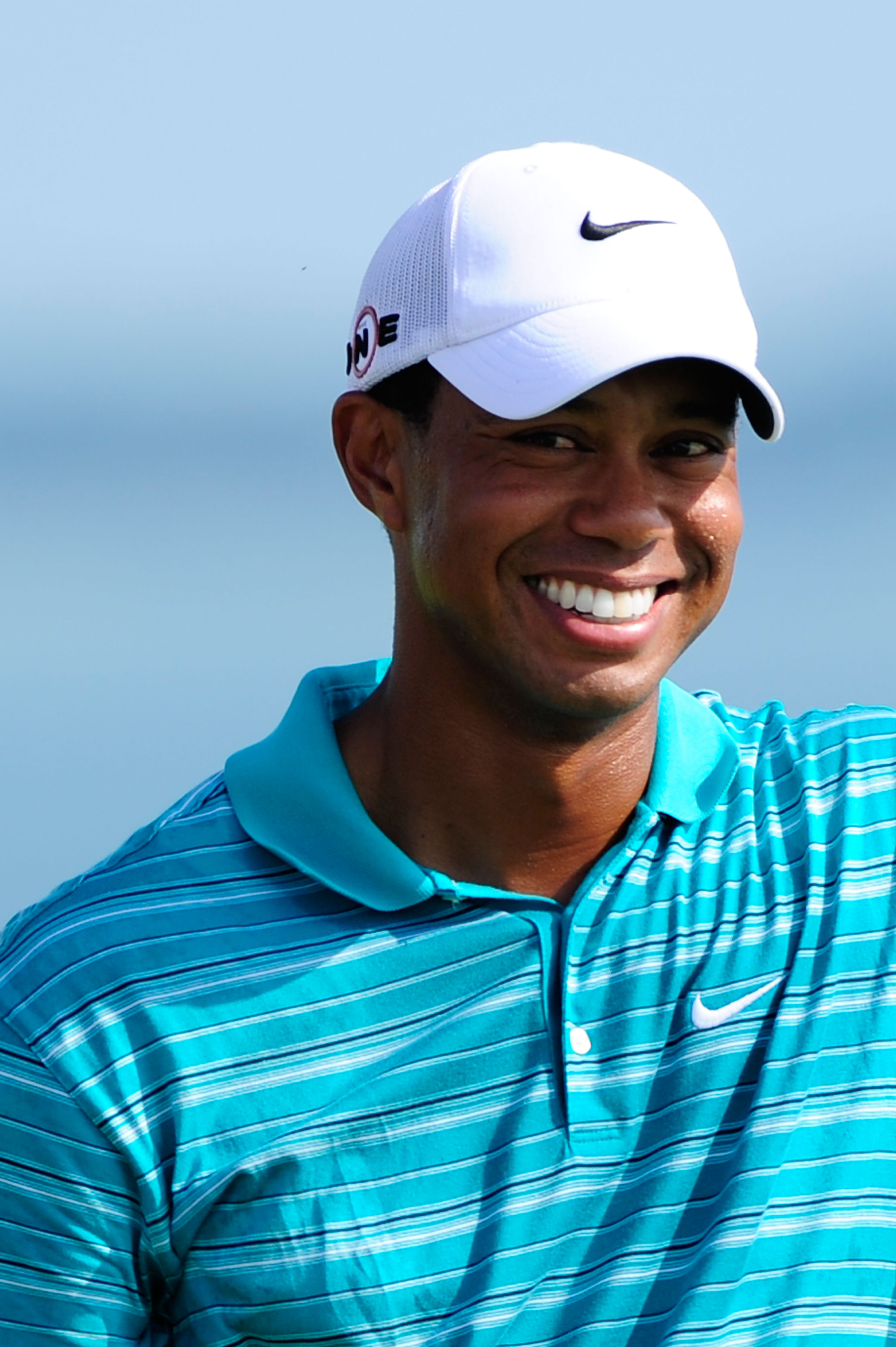 KOHLER, WI - AUGUST 14:  Tiger Woods smiles on the 15th tee during the continuation of the second round of the 92nd PGA Championship on the Straits Course at Whistling Straits on August 14, 2010 in Kohler, Wisconsin.  (Photo by Stuart Franklin/Getty Image