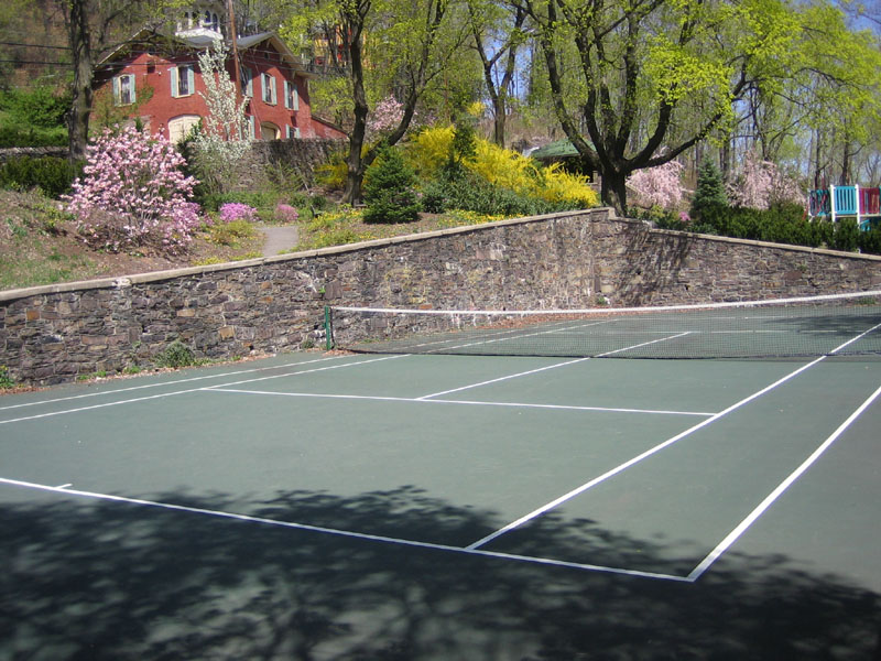 Tiger's courts will look just like this, but without the houses or happy playground nearby.