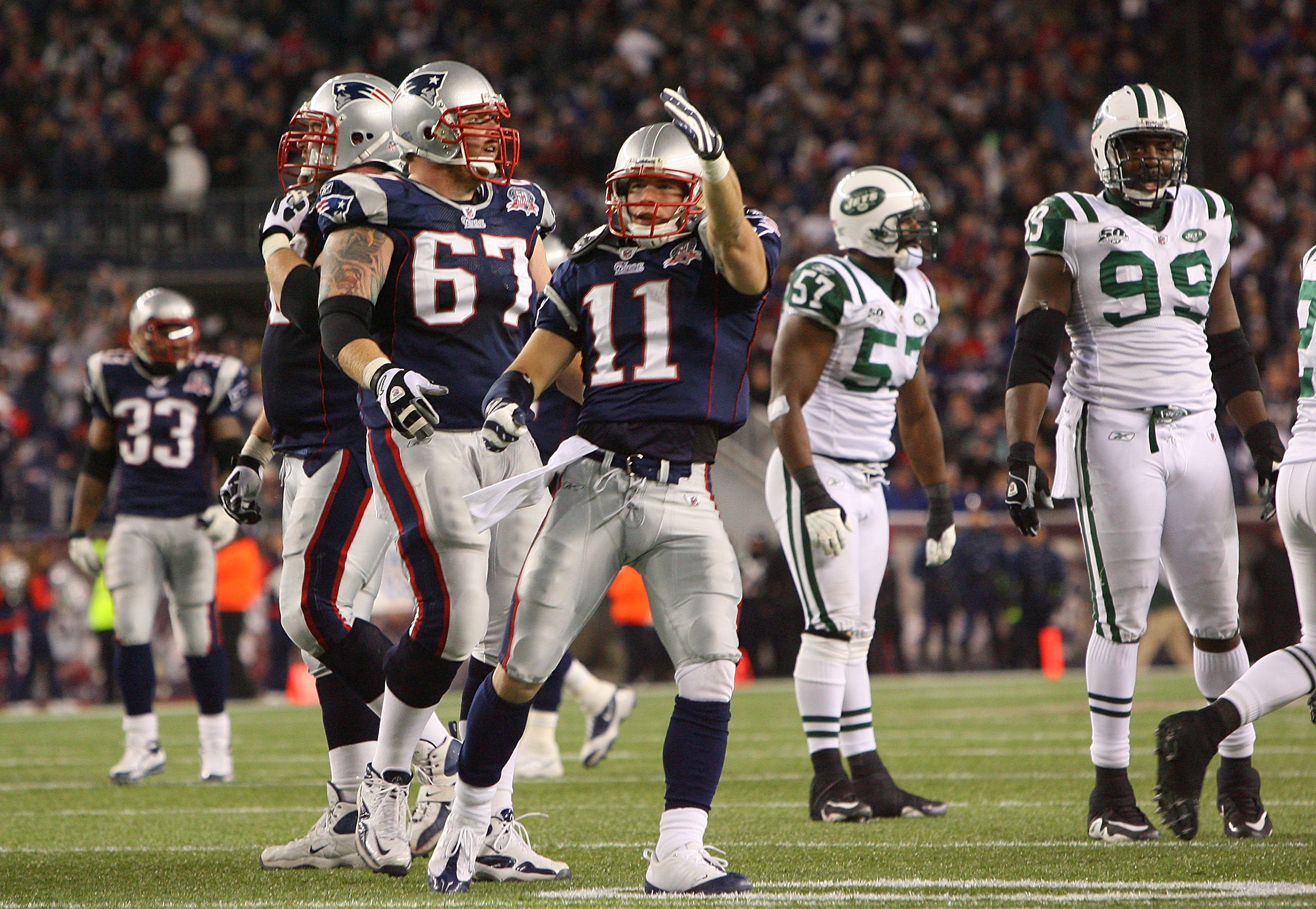 FOXBORO, MA - NOVEMBER 22:  Julian Edelman #11 and Dan Koppen #67 of the New England Patriots react in the fourth quarter against the New York Jets at Gillette Stadium on November 22, 2009 in Foxboro, Massachusetts. The Patriots won 31-14. (Photo by Jim R