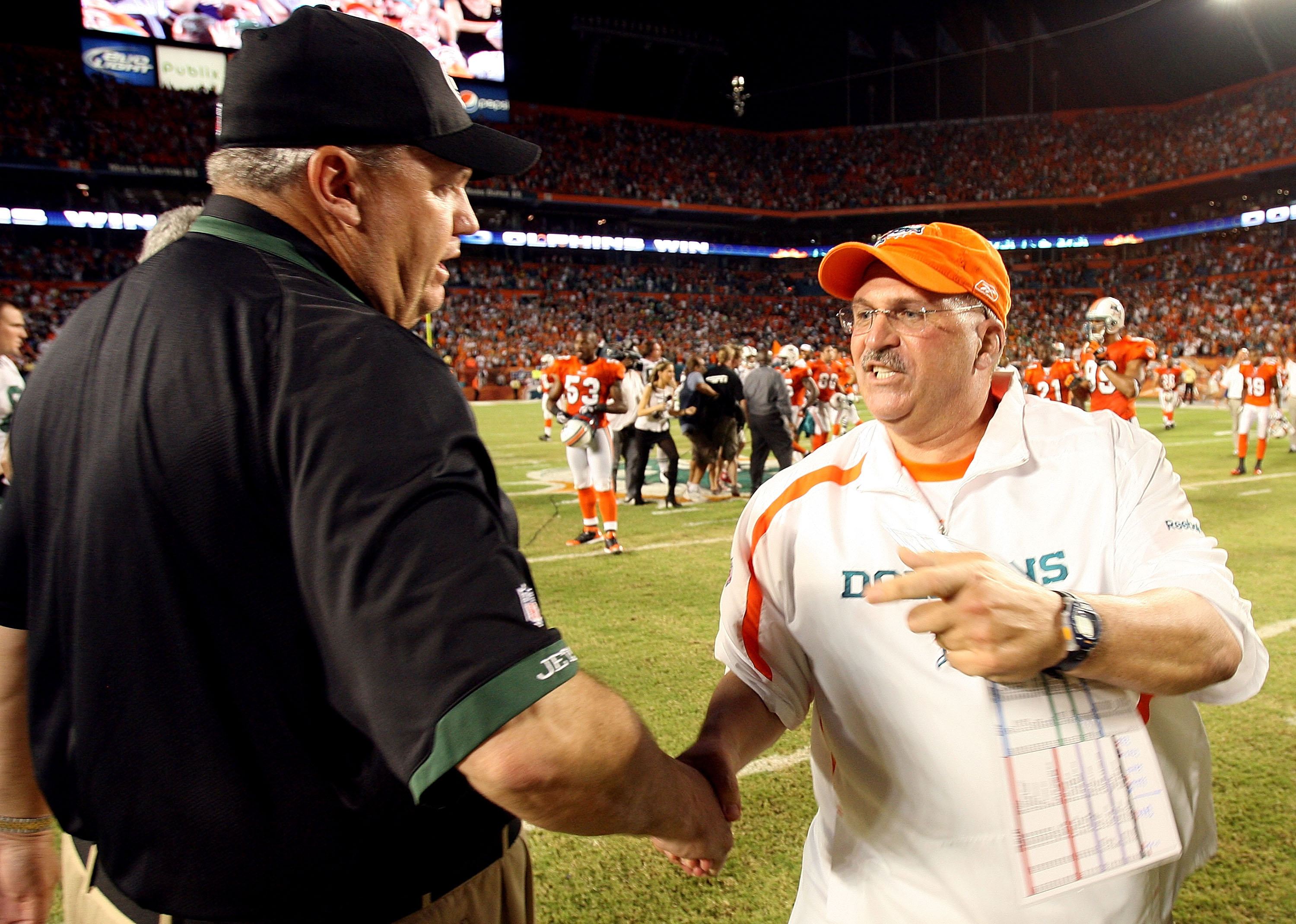 MIAMI - OCTOBER 12:  Head coach Rex Ryan of the New York Jets congratulates head coach Tony Sparano of the Miami Dolphins at Land Shark Stadium on October 12, 2009 in Miami, Florida. The Dolphins defeated the Jets 31-27.  (Photo by Doug Benc/Getty Images)