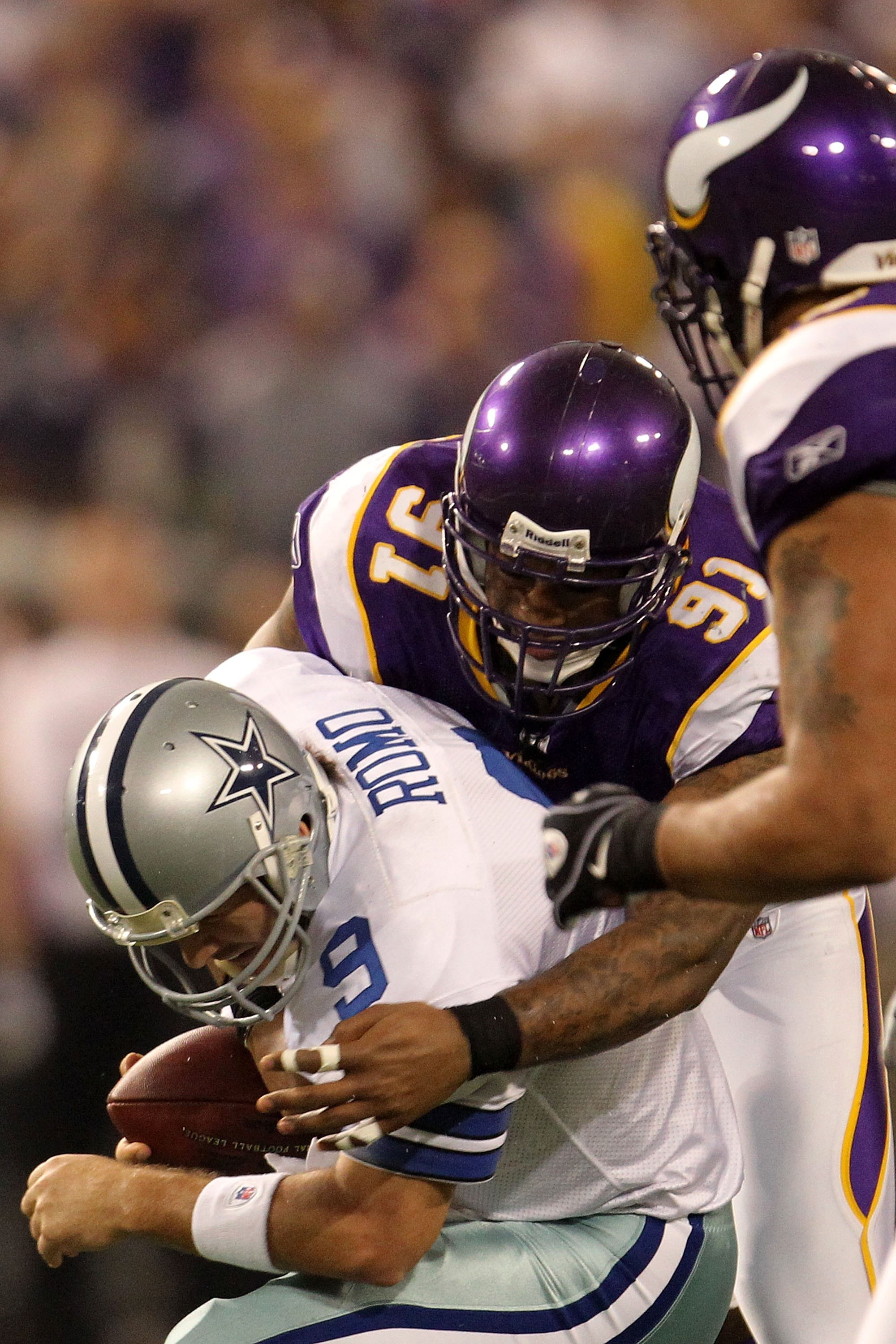 MINNEAPOLIS - JANUARY 17:  Tony Romo #9 of the Dallas Cowboy is sacked by Ray Edwards #91 of the Minnesota Vikings during the NFC Divisional Playoff Game at Hubert H. Humphrey Metrodome on January 17, 2010 in Minneapolis, Minnesota. The Vikings defeated t