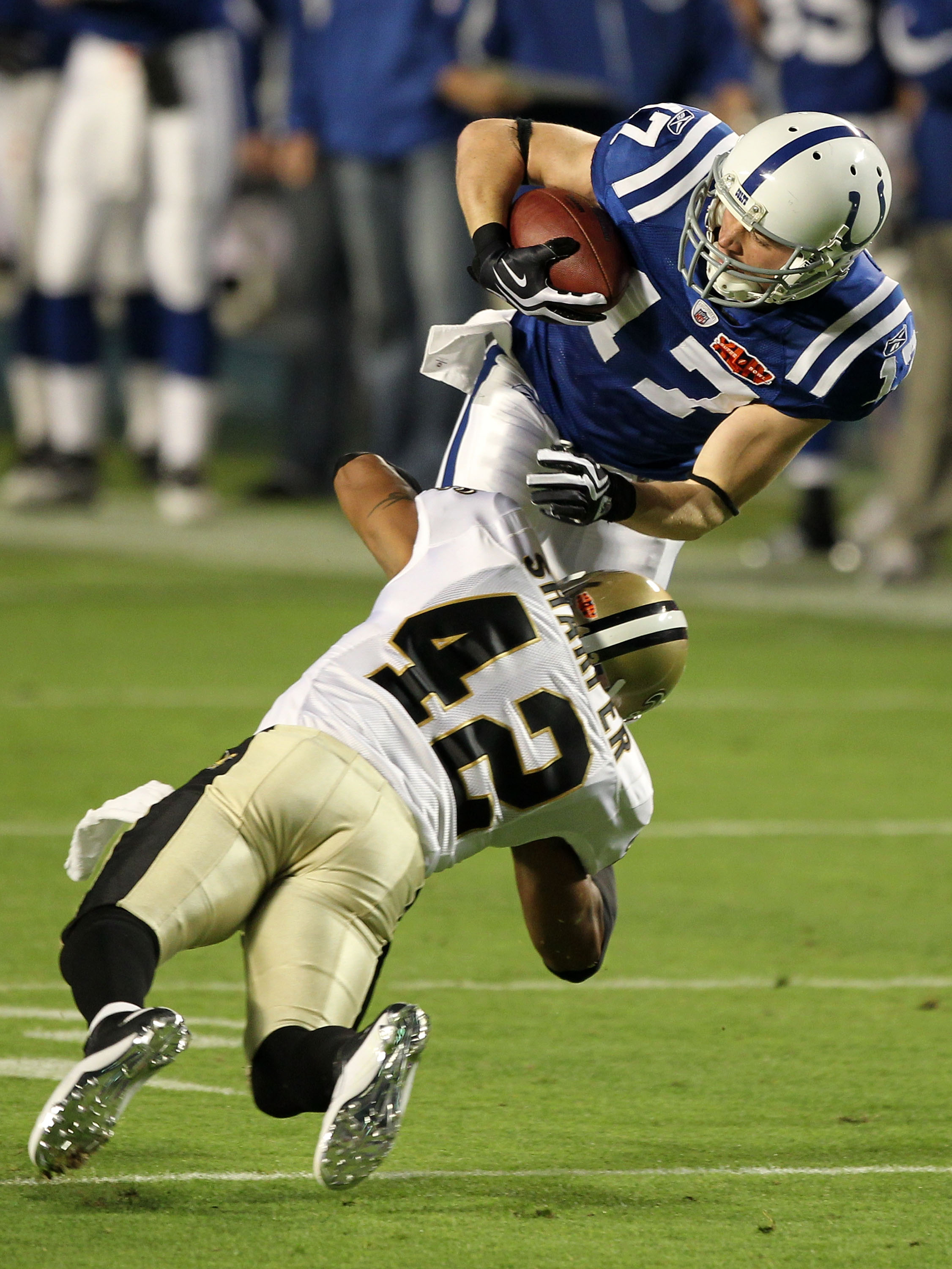 MIAMI GARDENS, FL - FEBRUARY 07:   Austin Collie #17 of the Indianapolis Colts is tacked after making a catch by Darren Sharper #42 of the New Orleans Saints during Super Bowl XLIV on February 7, 2010 at Sun Life Stadium in Miami Gardens, Florida.  (Photo