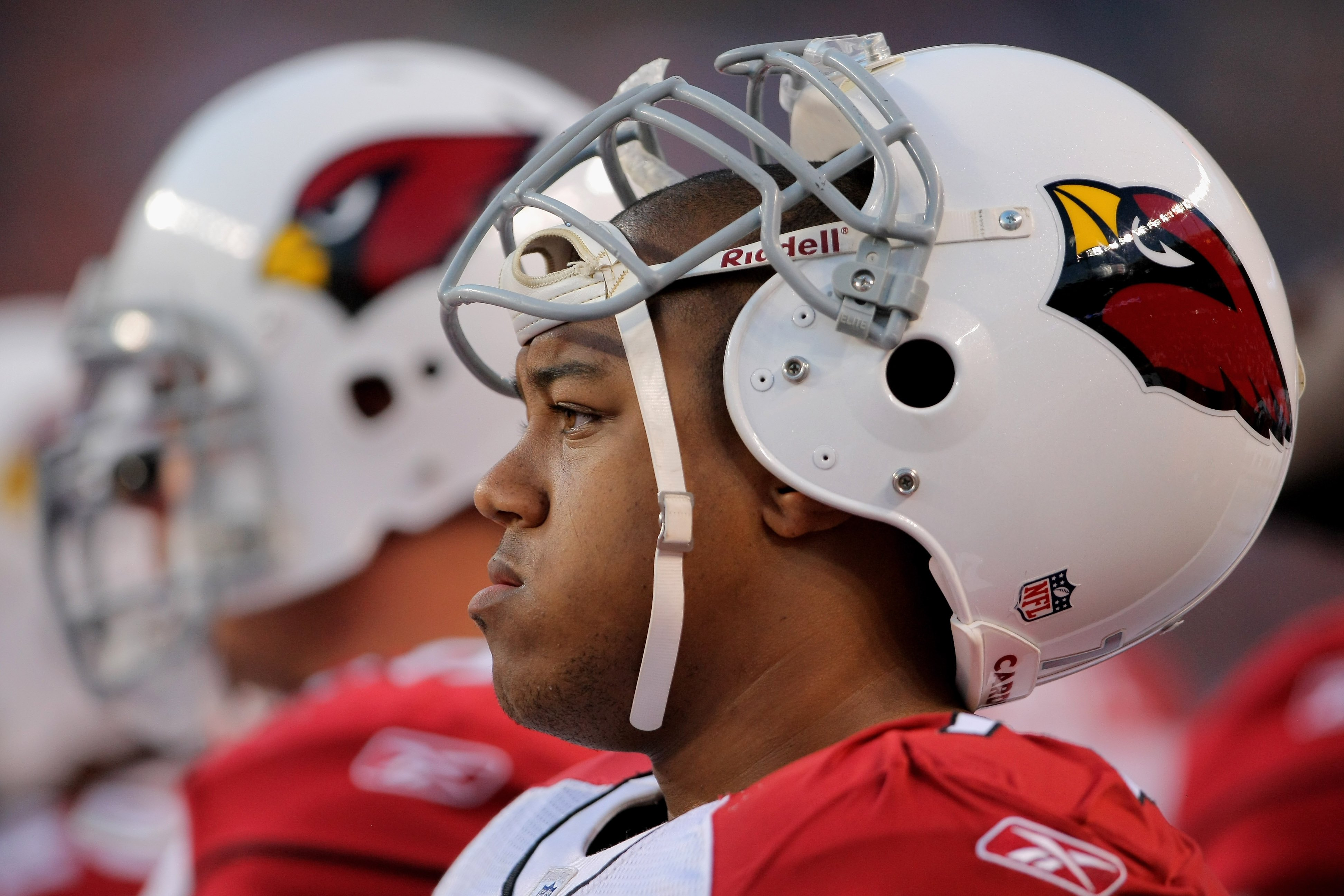 DENVER - SEPTEMBER 03:  Guard Reggie Wells #74 of the Arizona Cardinals awaits action on the sidelines against the Denver Broncos during NFL preseason action at Invesco Field at Mile High on September 3, 2009 in Denver, Colorado. The Broncos defeated the