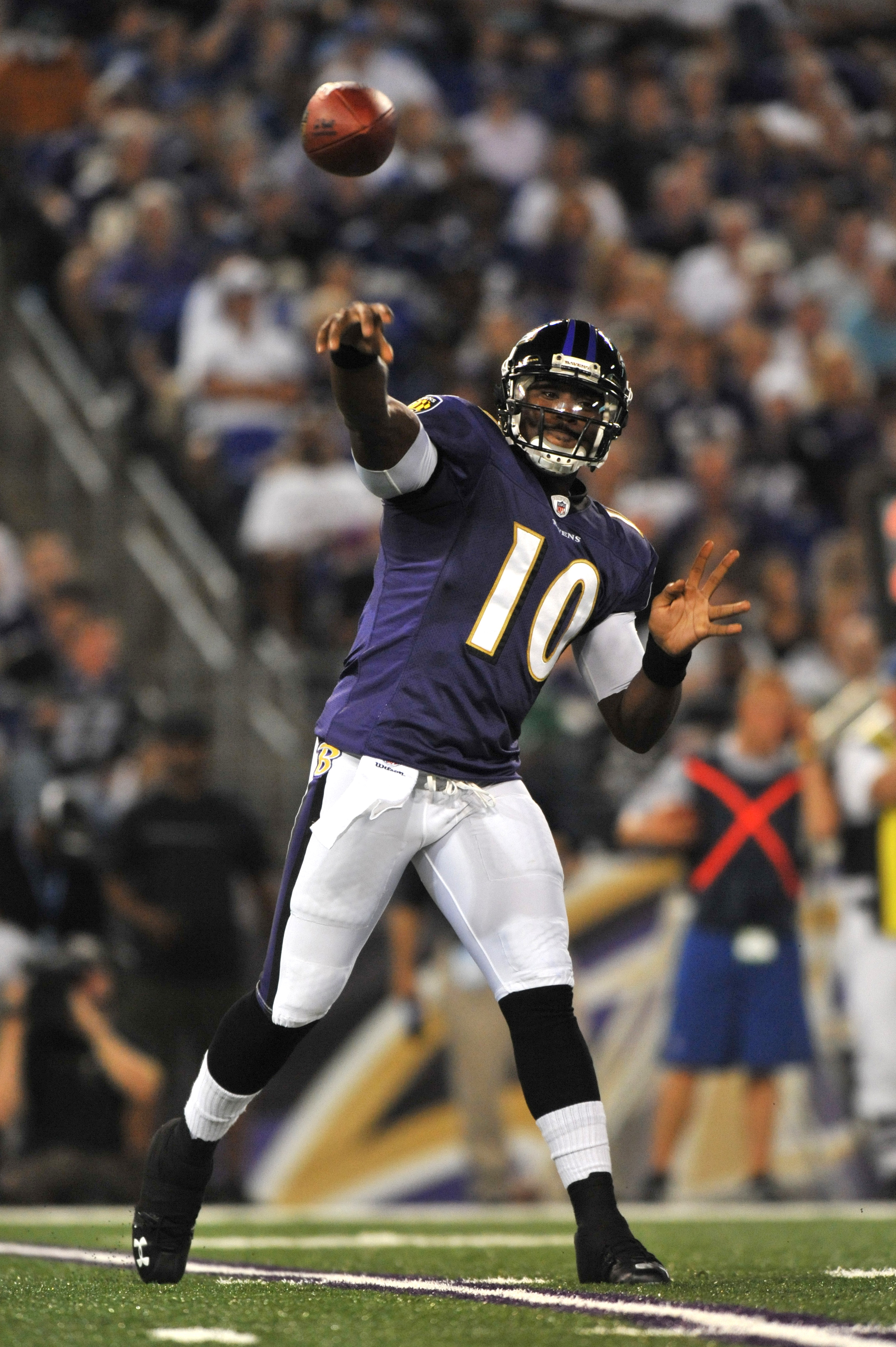 BALTIMORE - AUGUST 28:  Troy Smith #10 of the Baltimore Ravens passes against the New York Giants in a preseason game at M&T Bank Stadium on August 28, 2010 in Baltimore, Maryland. The Ravens defeated the Giants 24-10. (Photo by Larry French/Getty Images)