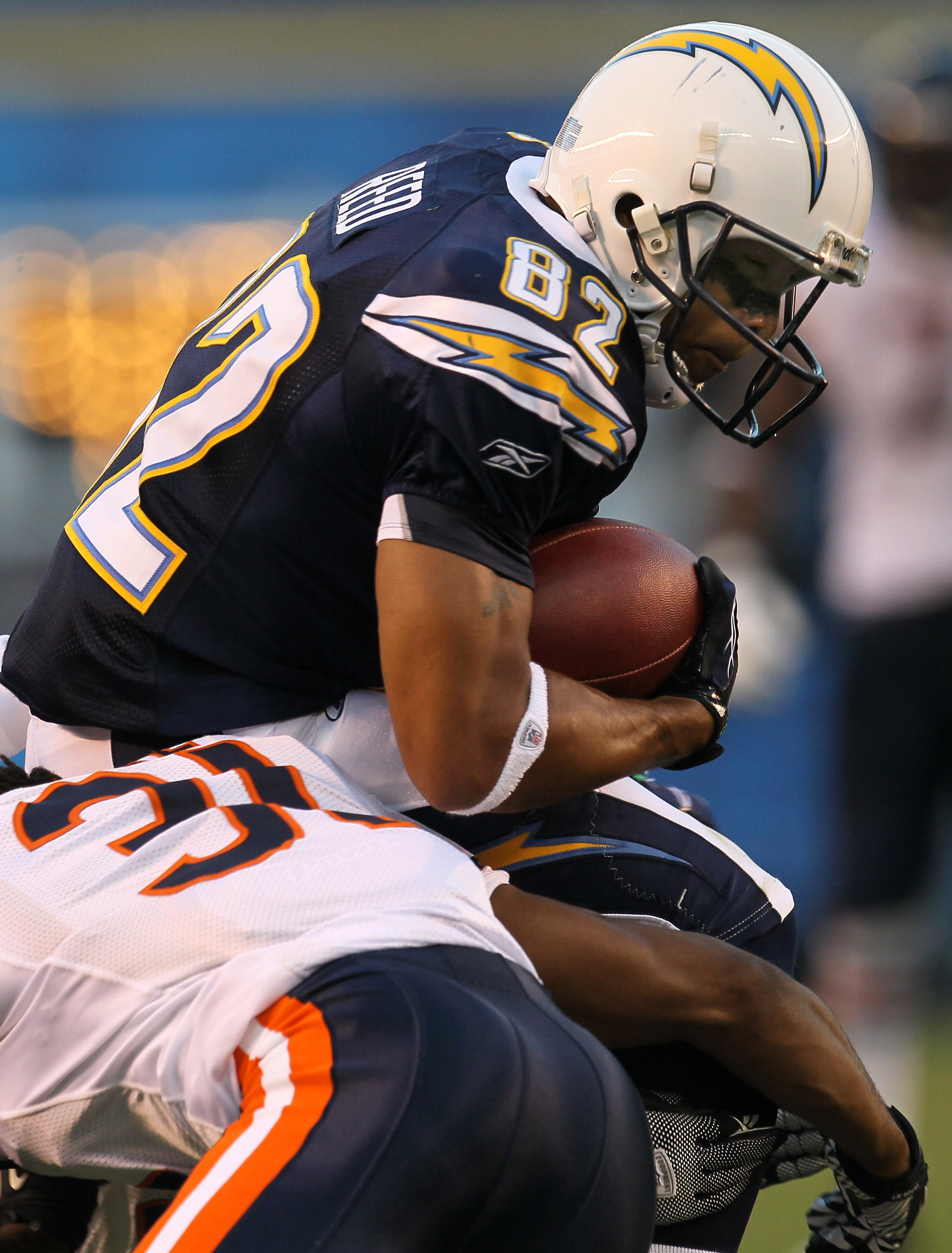 SAN DIEGO - AUGUST 14:   Wide receiver Josh Reed #82 of the San Diego Chargers carries the ball against the Chicago Bears on August 14, 2010 at Qualcomm Stadium in San Diego, California.   (Photo by Stephen Dunn/Getty Images)
