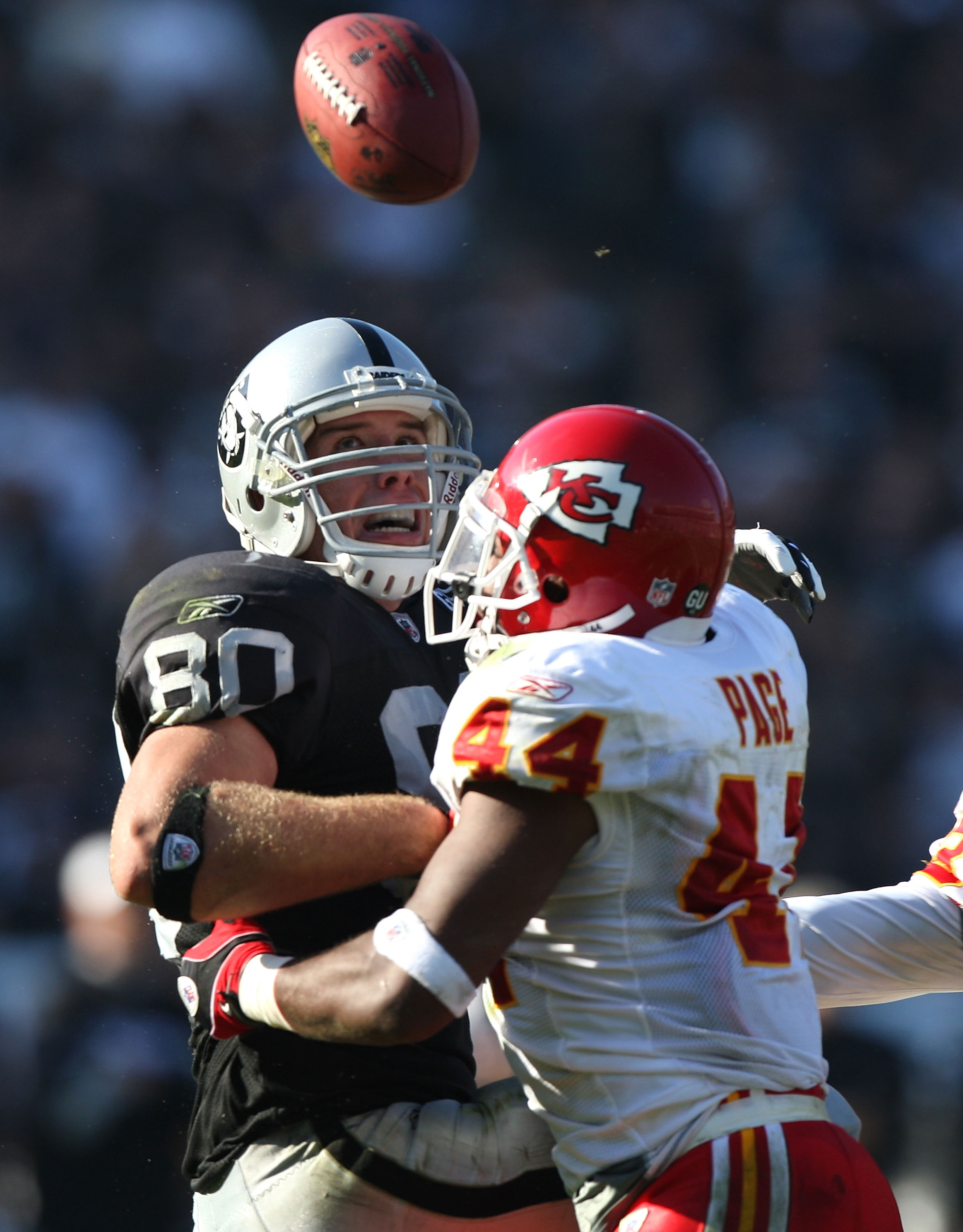 OAKLAND, CA - NOVEMBER 30: Jarrad Page #44 of the Kansas City Chiefs breaks up a pass to Zach Miller #80 of the Oakland Raiders during an NFL game on November 30, 2008 at the Oakland-Alameda County Coliseum in Oakland, California. (Photo by Jed Jacobsohn/