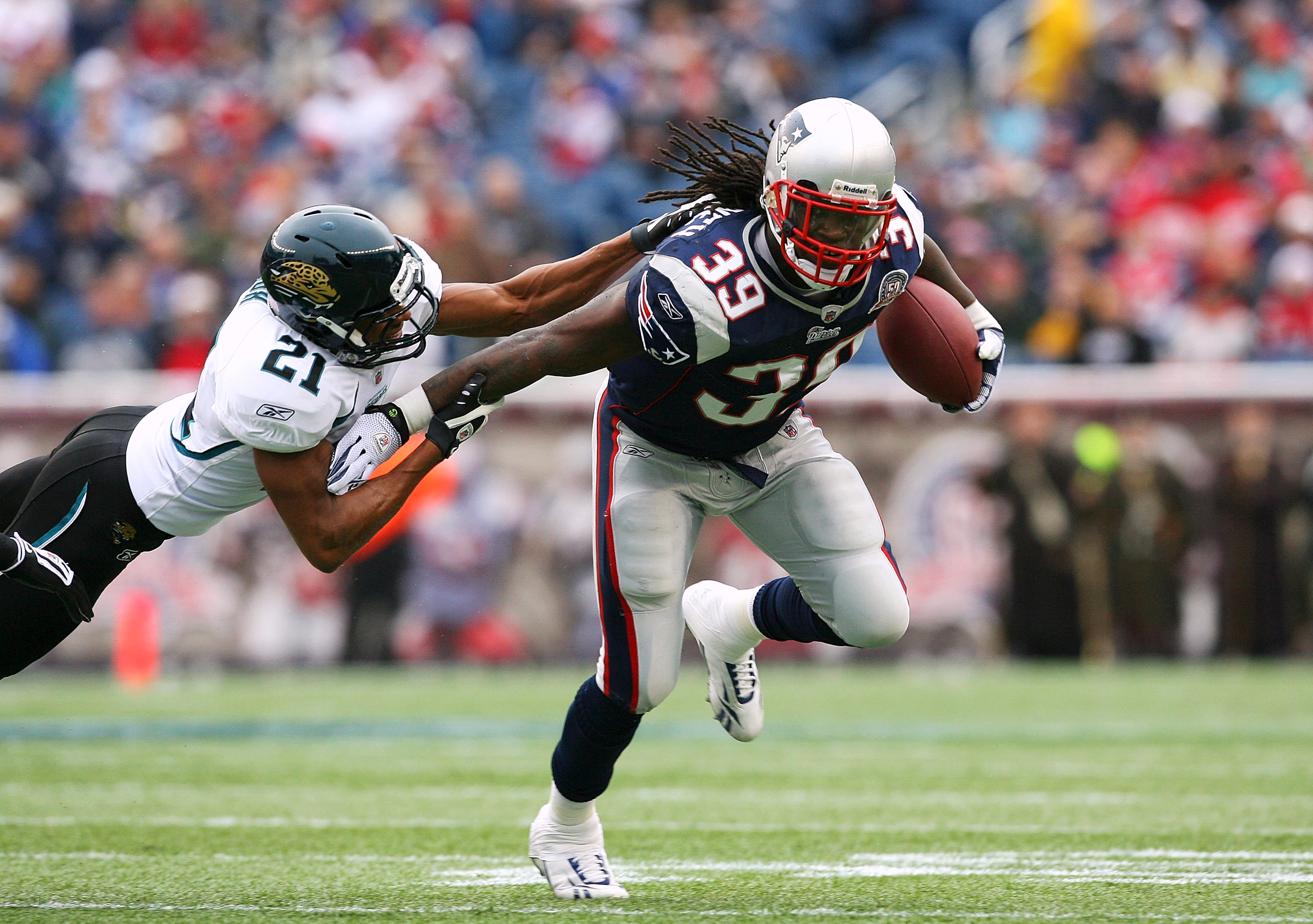 FOXBORO, MA - DECEMBER 27:  Laurence Maroney #39 of the New England Patriots gains yards against Derek Cox #21 of the Jacksonville Jaguars in the first quarter at Gillette Stadium on December 27, 2009 in Foxboro, Massachusetts. (Photo by Jim Rogash/Getty