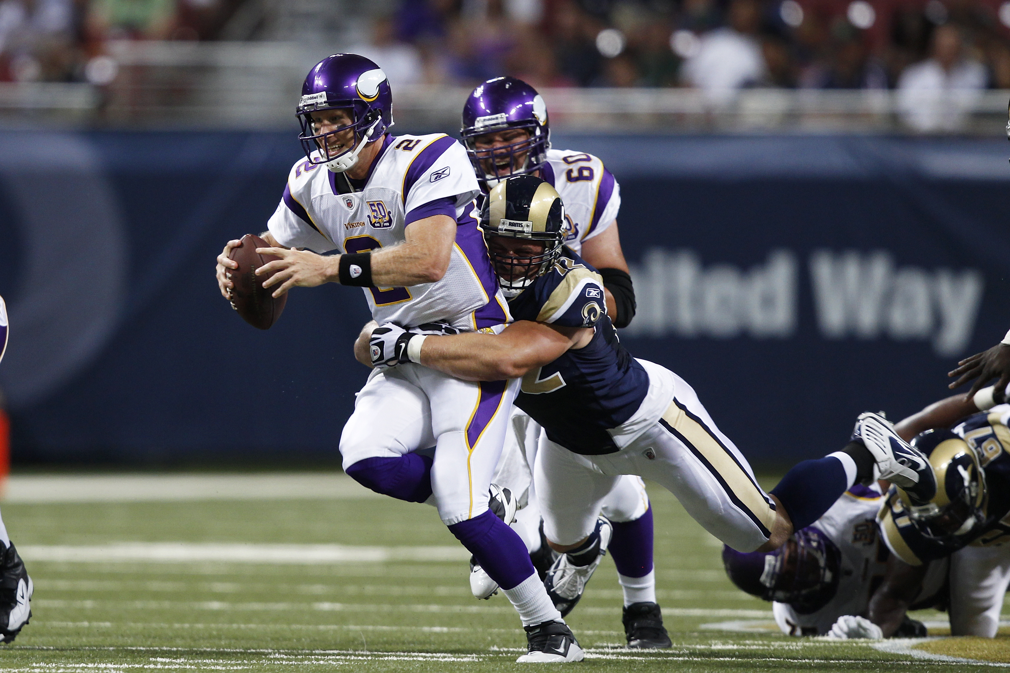 ST. LOUIS, MO - AUGUST 14: Sage Rosenfels #2 of the Minnesota Vikings gets sacked by Chris Long #72 of the St. Louis Rams during the preseason game at Edward Jones Dome on August 14, 2010 in St. Louis, Missouri. (Photo by Joe Robbins/Getty Images)
