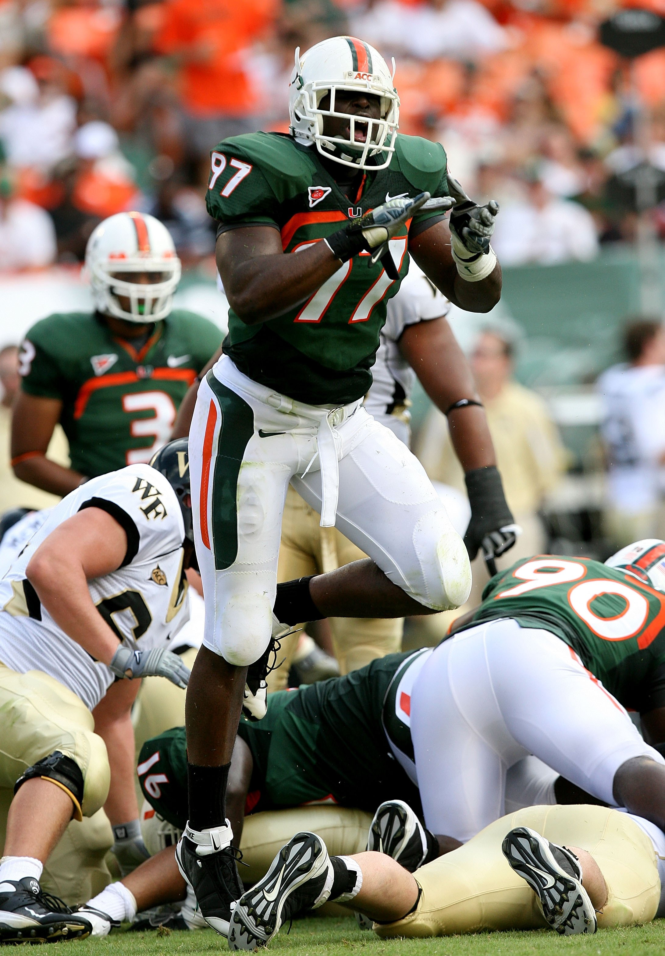MIAMI - OCTOBER 25:  Defensive lineman Adewale Ojomo #97 of the Miami Hurricanes celebrates after making a tackle for a loss of yardage against the Wake Forest Demon Decons at Dolphin Stadium on October 25, 2008 in Miami, Florida. Miami defeated Wake Fore