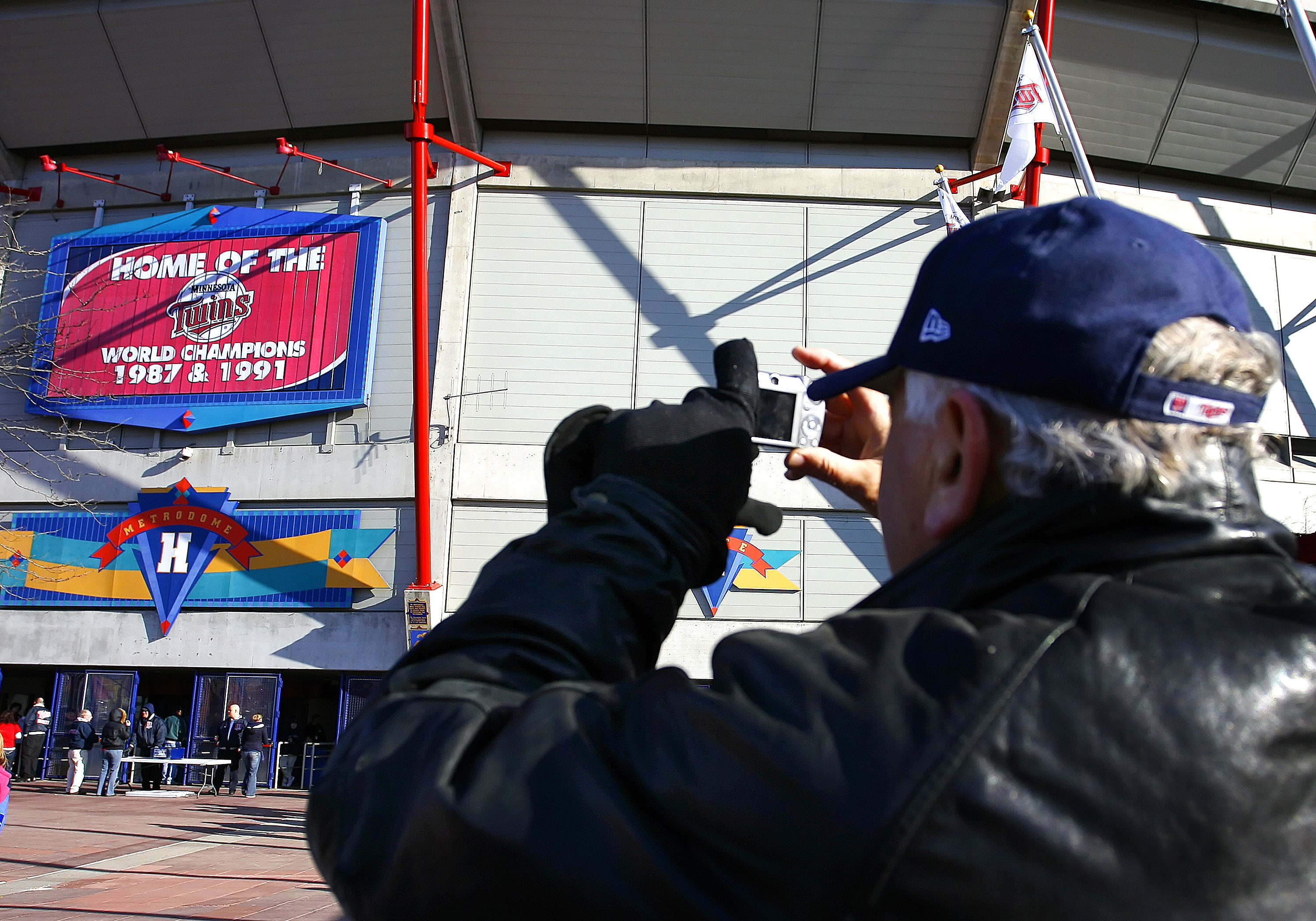 MINNEAPOLIS, MN - APRIL 6: A fan takes a picture of the Metrodome, the Minnesota Twins home in Minneapolis, Minnesota April 6, 2009. It's the last home opener for the Twins at the Metrodome; they'll open at the new Target Field, also in Minneapolis, in 20