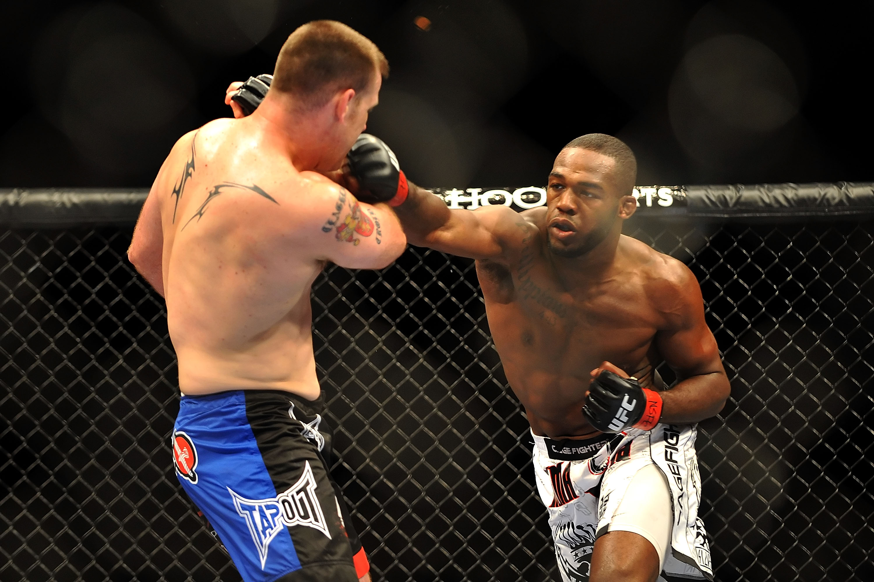LAS VEGAS - JULY 11:  (R-L) Jon Jones connects with a right punch on Jake O'Brein during their light heavyweight bout during UFC 100 on July 11, 2009 in Las Vegas, Nevada. Jones defeated O'Brein by second round tapout.  (Photo by Jon Kopaloff/Getty Images