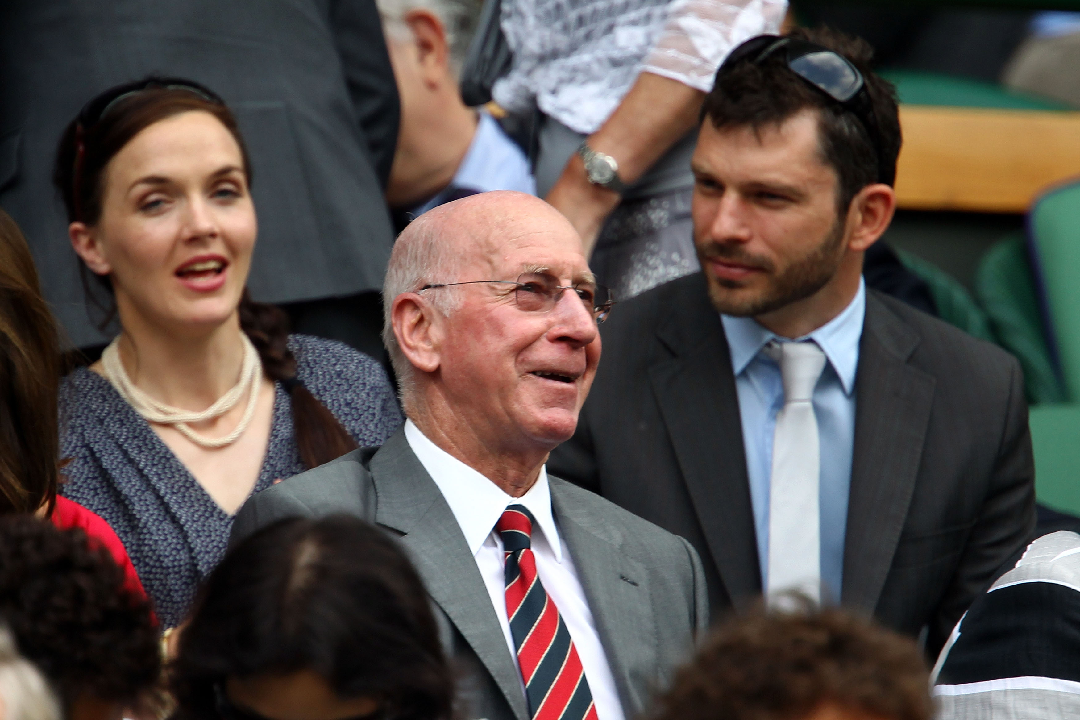 LONDON, ENGLAND - JUNE 26:  Victoria Pendleton (L) and Sir Bobby Charlton (C) watch a match at Centre Court on Day Six of the Wimbledon Lawn Tennis Championships at the All England Lawn Tennis and Croquet Club on June 26, 2010 in London, England.  (Photo