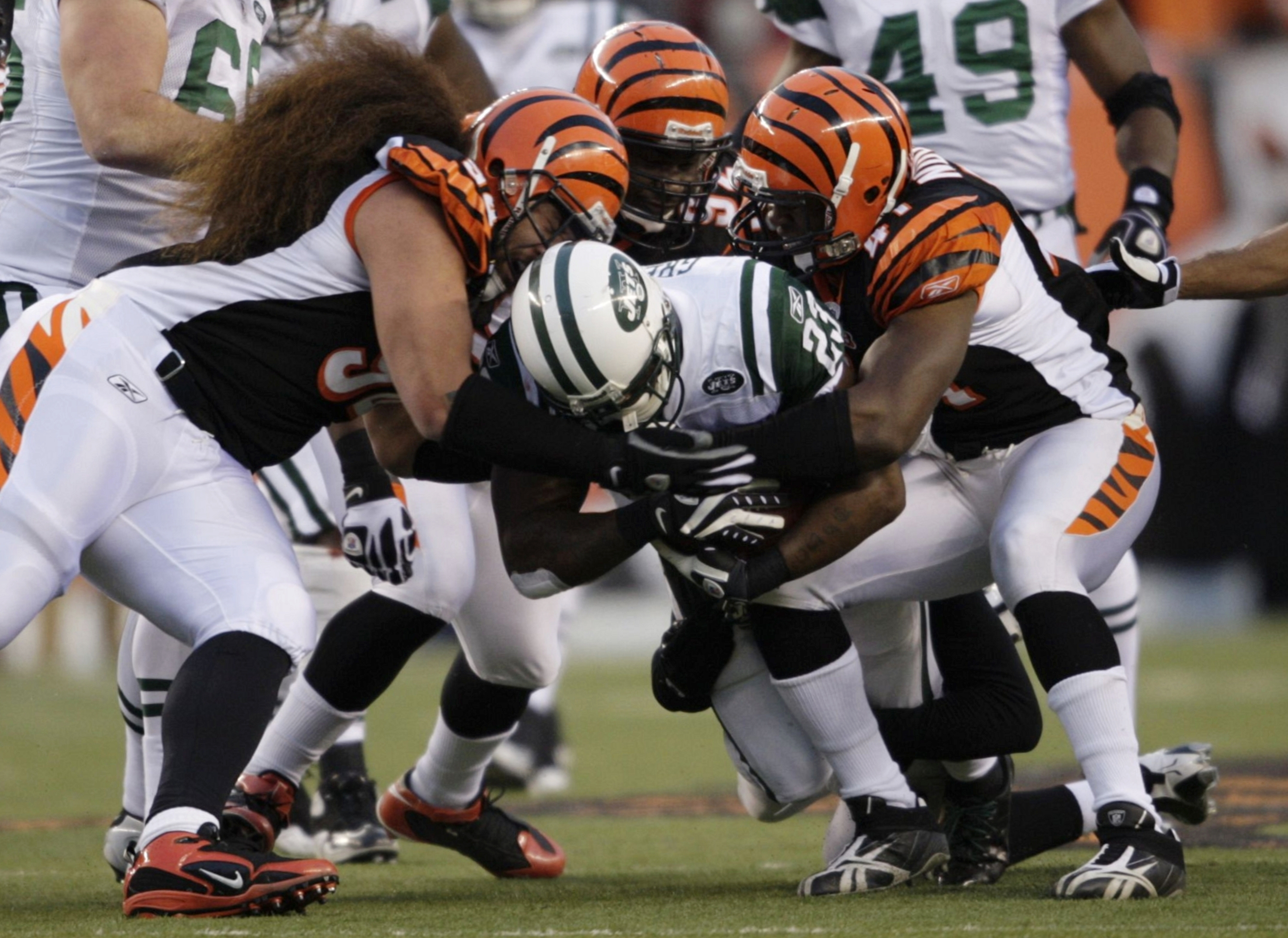 CINCINNATI - JANUARY 9: Running back Shonn Greene #23 of the New York Jets is tackled as he runs with the ball against the Cincinnati Bengals during the 2010 AFC wild-card playoff game at Paul Brown Stadium on January 9, 2010 in Cincinnati, Ohio. (Photo b