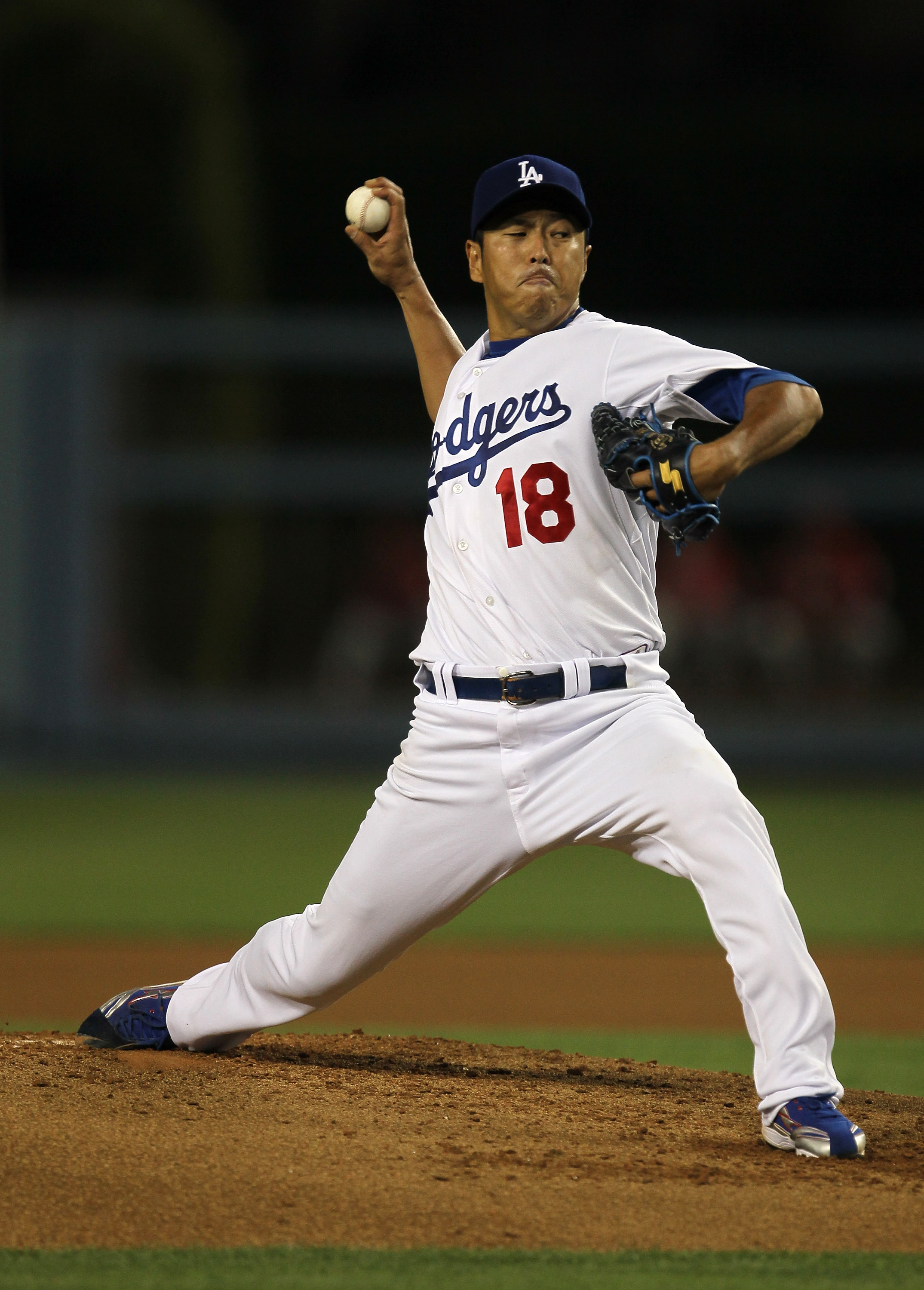 LOS ANGELES, CA - AUGUST 30:  Hiroki Kuroda #18 of the Los Angeles Dodgers throws a pitch against the Philadelphia Phillies on August 30, 2010 at Dodger Stadium  in Los Angeles, California.  (Photo by Stephen Dunn/Getty Images)