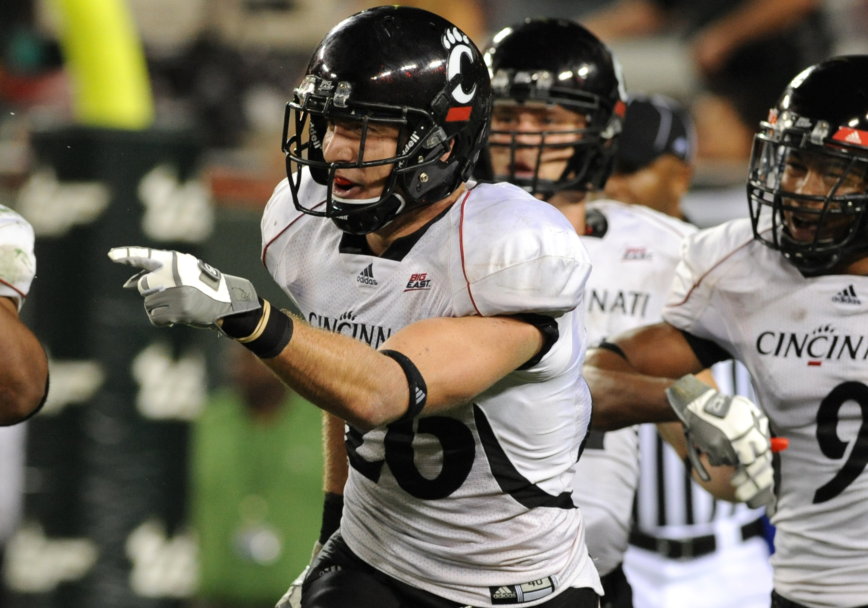 TAMPA, FL - OCTOBER 15:  Safety Drew Frey #26 of the Cincinnati Bearcats celebrates an interception against the University of South Florida Bulls October 15, 2009 at Raymond James Stadium in Tampa, Florida.  (Photo by Al Messerschmidt/Getty Images)