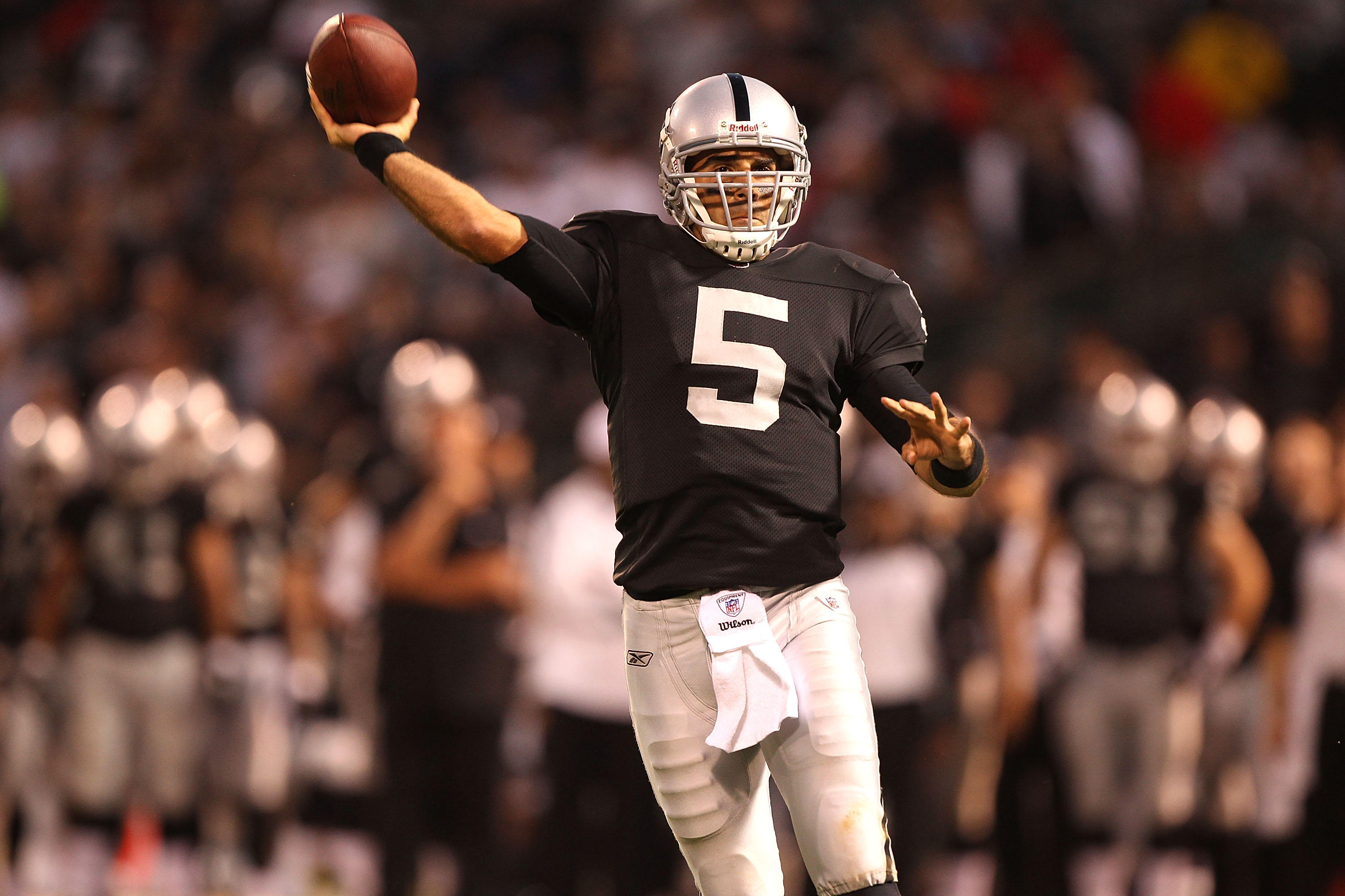 OAKLAND, CA - SEPTEMBER 02:  Bruce Gradkowski #11 of the Oakland Raiders passes against the Seattle Seahawks during an NFL preseason game at Oakland-Alameda County Coliseum on September 2, 2010 in Oakland, California.  (Photo by Jed Jacobsohn/Getty Images