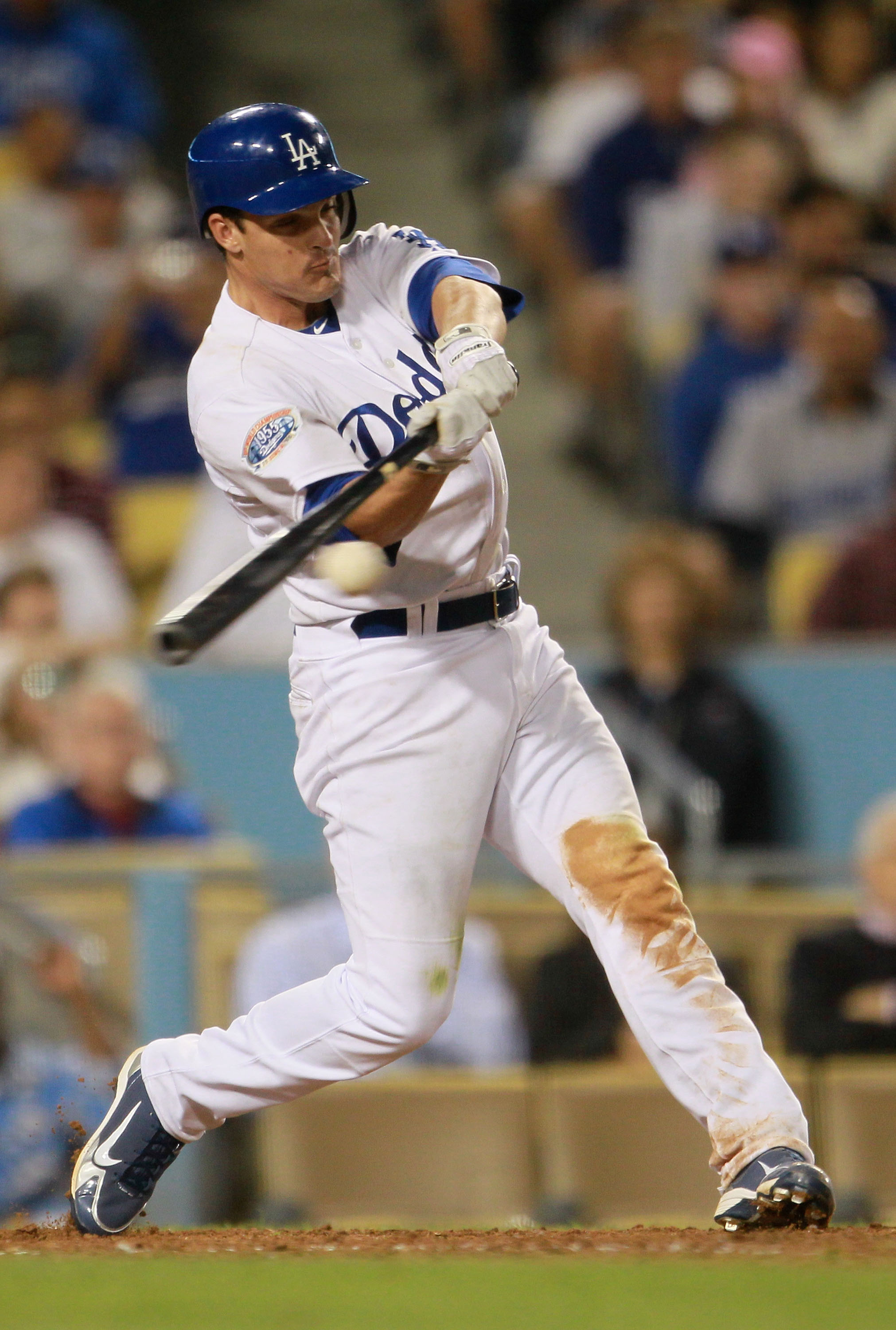 LOS ANGELES, CA - AUGUST 04:  Ryan Theriot #13 of the Los Angeles Dodgers hits a double scoring two runs in the eighth inning against the San Diego Padres at Dodger Stadium on August 4, 2010 in Los Angeles, California. The Dodgers defeated the Padres 9-0.