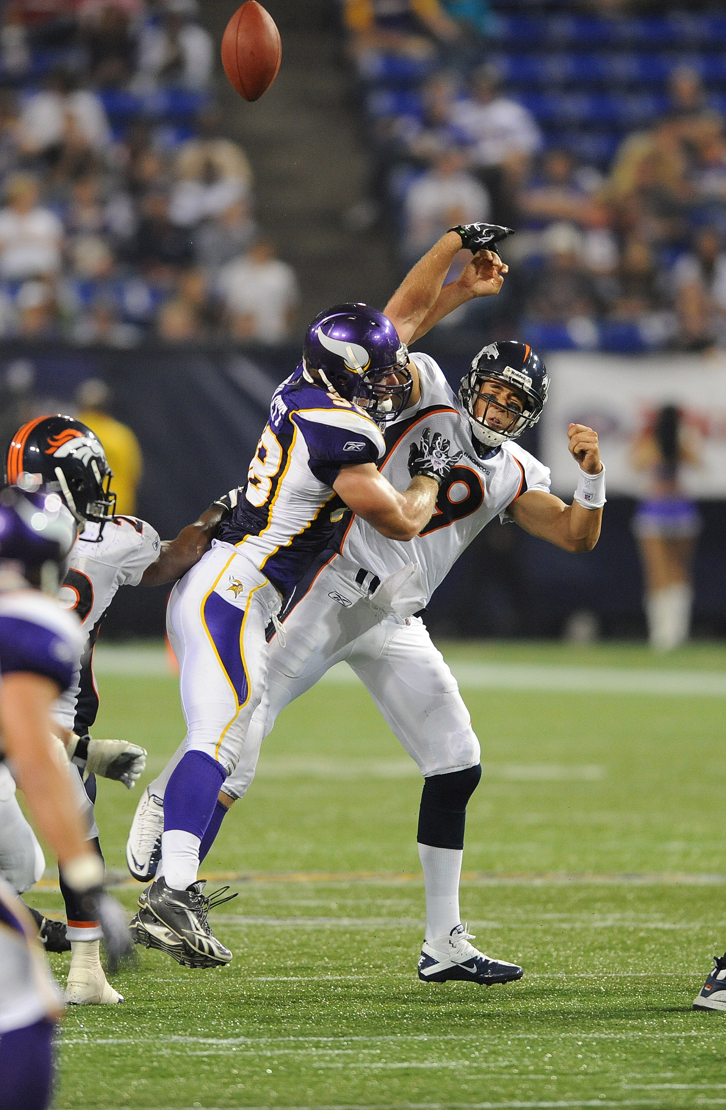 MINNEAPOLIS - SEPTEMBER 02:  Brady Quinn #9 of the Denver Broncos passes the ball as Nate Triplett #58 of the Minnesota Vikings defends during an NFL preseason game at the Mall of America Field at Hubert H. Humphrey Metrodome, on September 2, 2010 in Minn