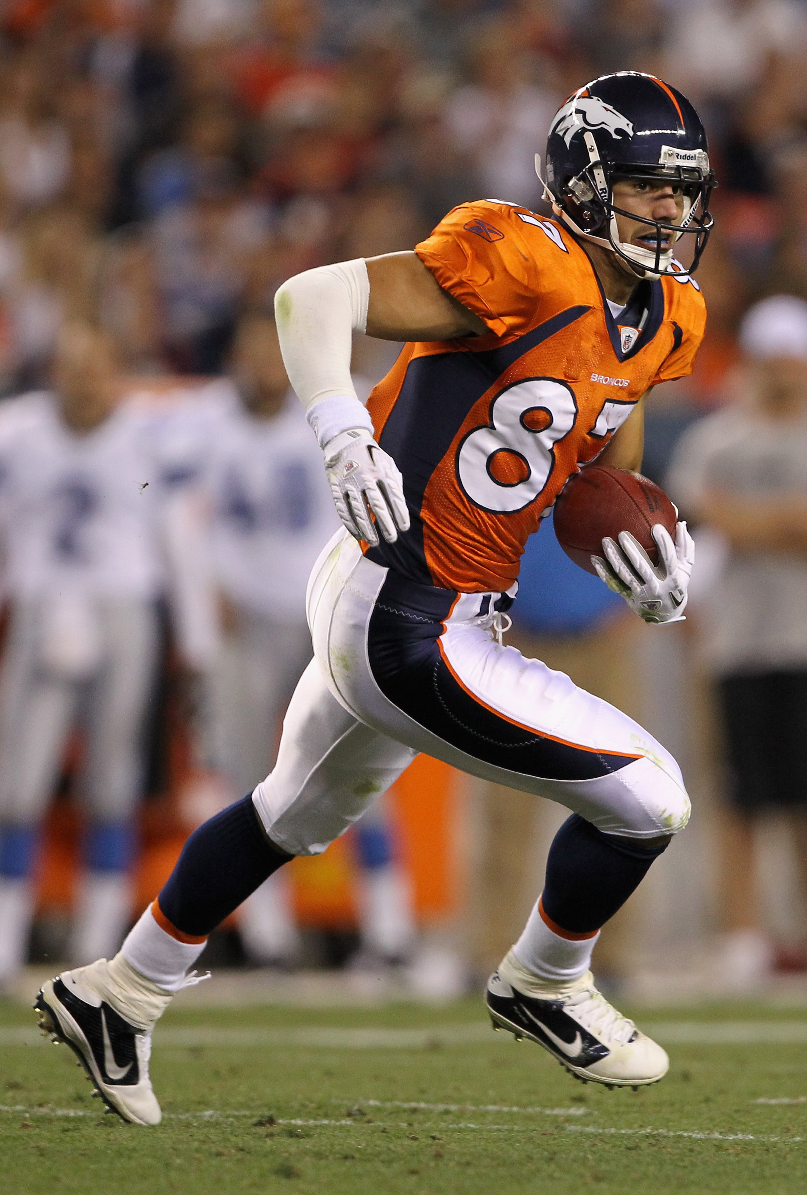 DENVER - AUGUST 21:  Wide receiver Eric Decker #87 of the Denver Broncos makes a reception against the Detroit Lions during preseason NFL action at INVESCO Field at Mile High on August 21, 2010 in Denver, Colorado. The Lions defeated the Broncos 25-20.  (