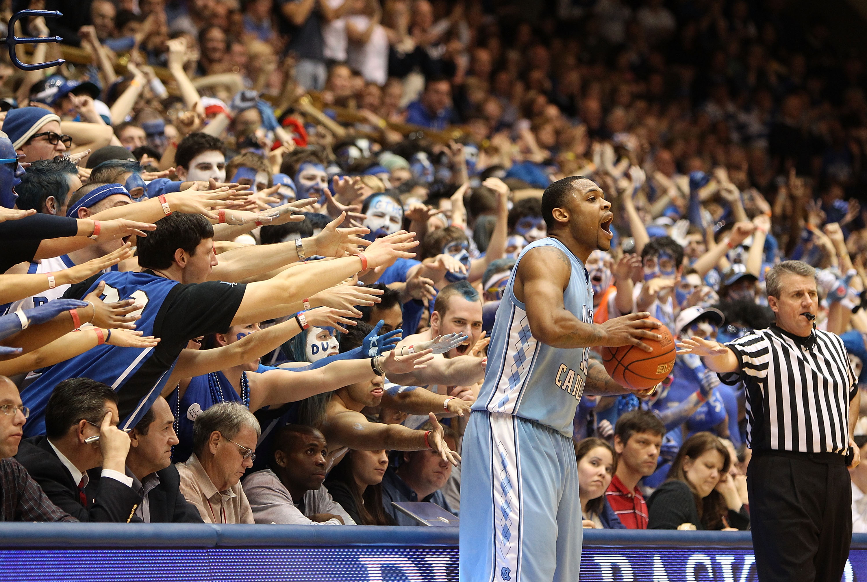 DURHAM, NC - MARCH 06:  Will Graves #13 of the North Carolina Tar Heels tries to throw the ball in bounds against the Duke Blue Devils during their game at Cameron Indoor Stadium on March 6, 2010 in Durham, North Carolina.  (Photo by Streeter Lecka/Getty