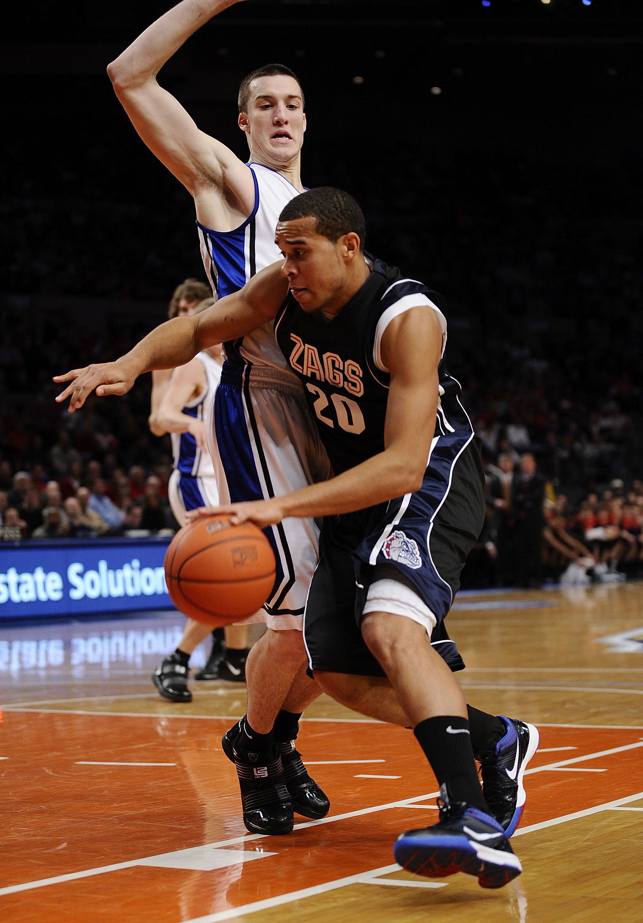 NEW YORK - DECEMBER 19:   Elias Harris #20 of the Gonzaga Bulldogs drives around Miles Plumlee #21 of the Duke Blue Devils in the first half of the Aeropostale Classic at Madison Square Garden on December 19, 2009 in New York City.  (Photo by Jeff Zelevan