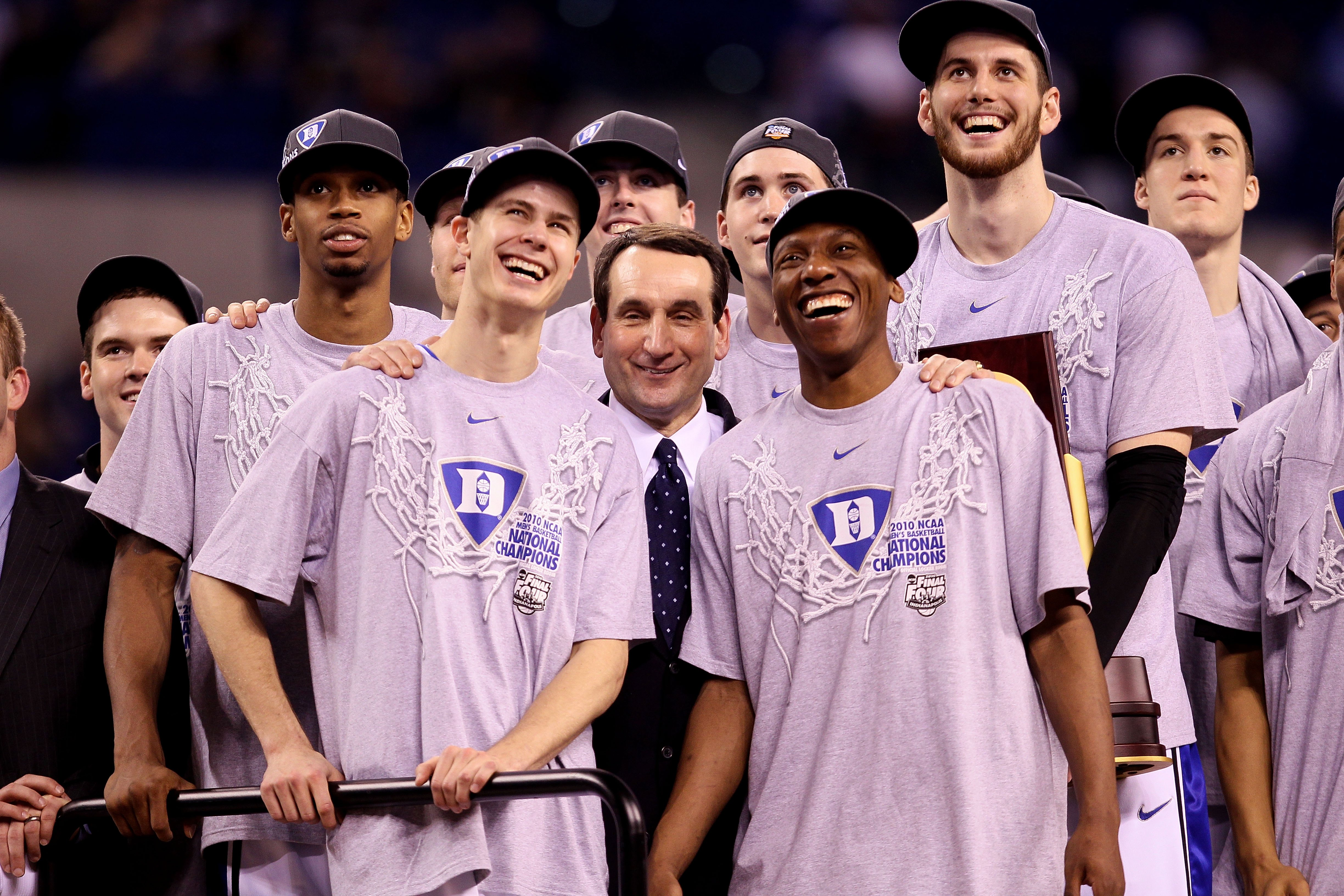 INDIANAPOLIS - APRIL 05:  (L-R) Lance Thomas #42 Jon Scheyer #30, head coach Mike Krzyzewski, Nolan Smith #2 and Brian Zoubek #55 of the Duke Blue Devils watch CBS 's presentation of 'One Shining Moment' as they celebrate after they won 61-59 against the