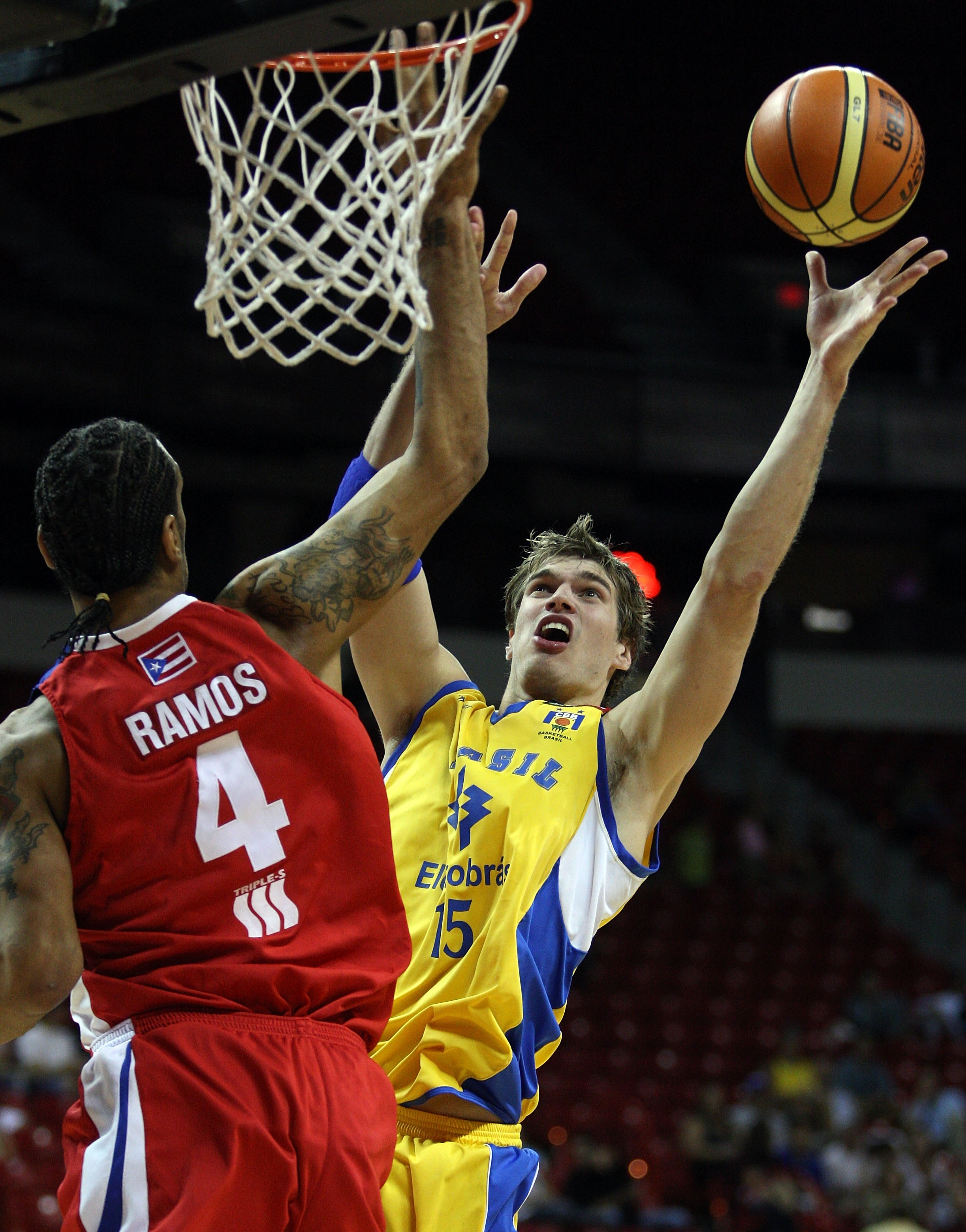 LAS VEGAS - SEPTEMBER 2:  Tiago Splitter #15 of Brazil shoots over Peter J. Ramos #4 of Puerto Rico during the FIBA Americas Championship 2007 Bronze Medal game at Thomas & Mack Center September 2, 2007 in Las Vegas, Nevada.  (Photo by Jamie Squire/Getty