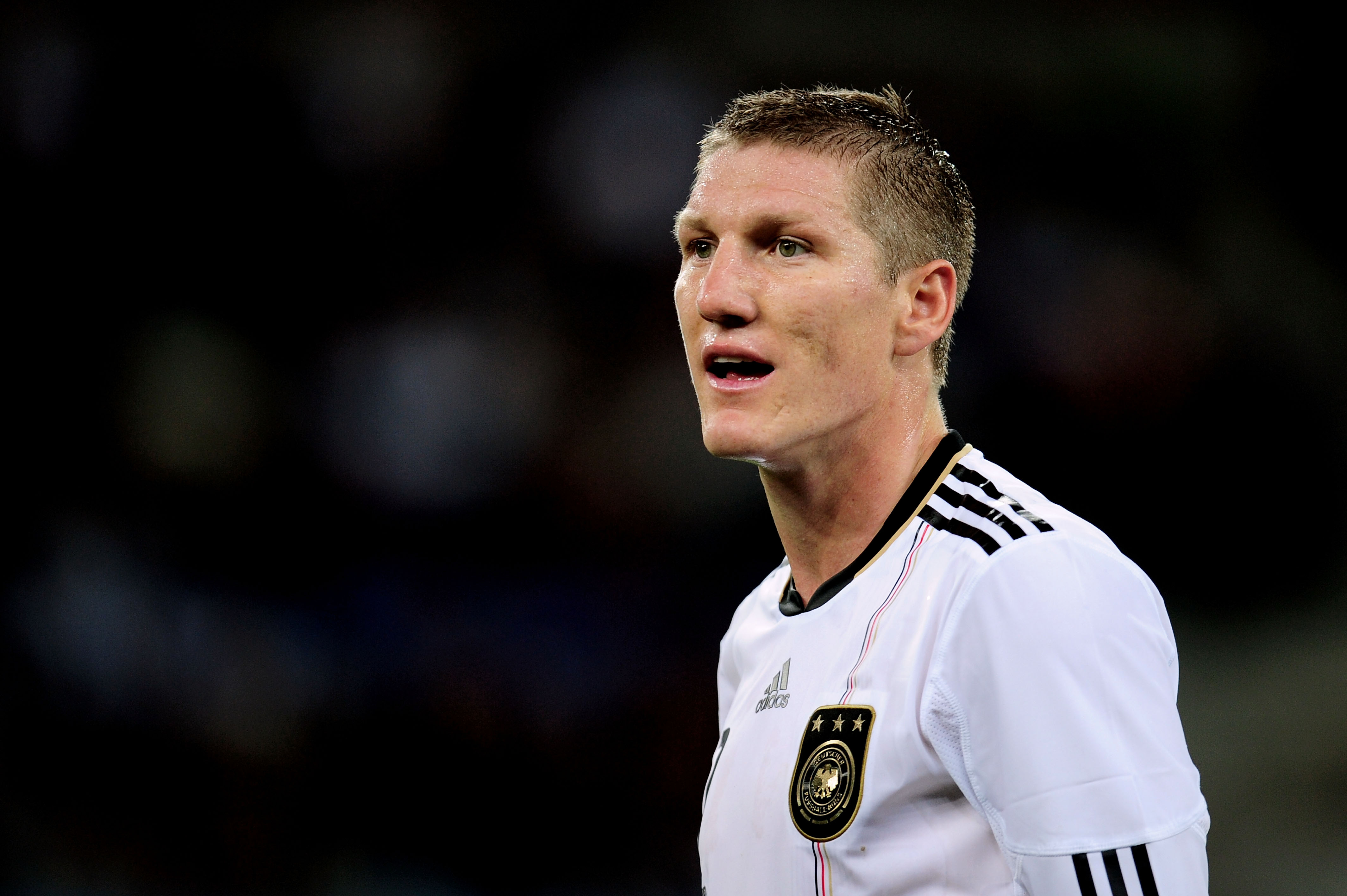 DURBAN, SOUTH AFRICA - JULY 07:  Bastian Schweinsteiger of Germany looks on during the 2010 FIFA World Cup South Africa Semi Final match between Germany and Spain at Durban Stadium on July 7, 2010 in Durban, South Africa.  (Photo by Clive Mason/Getty Imag