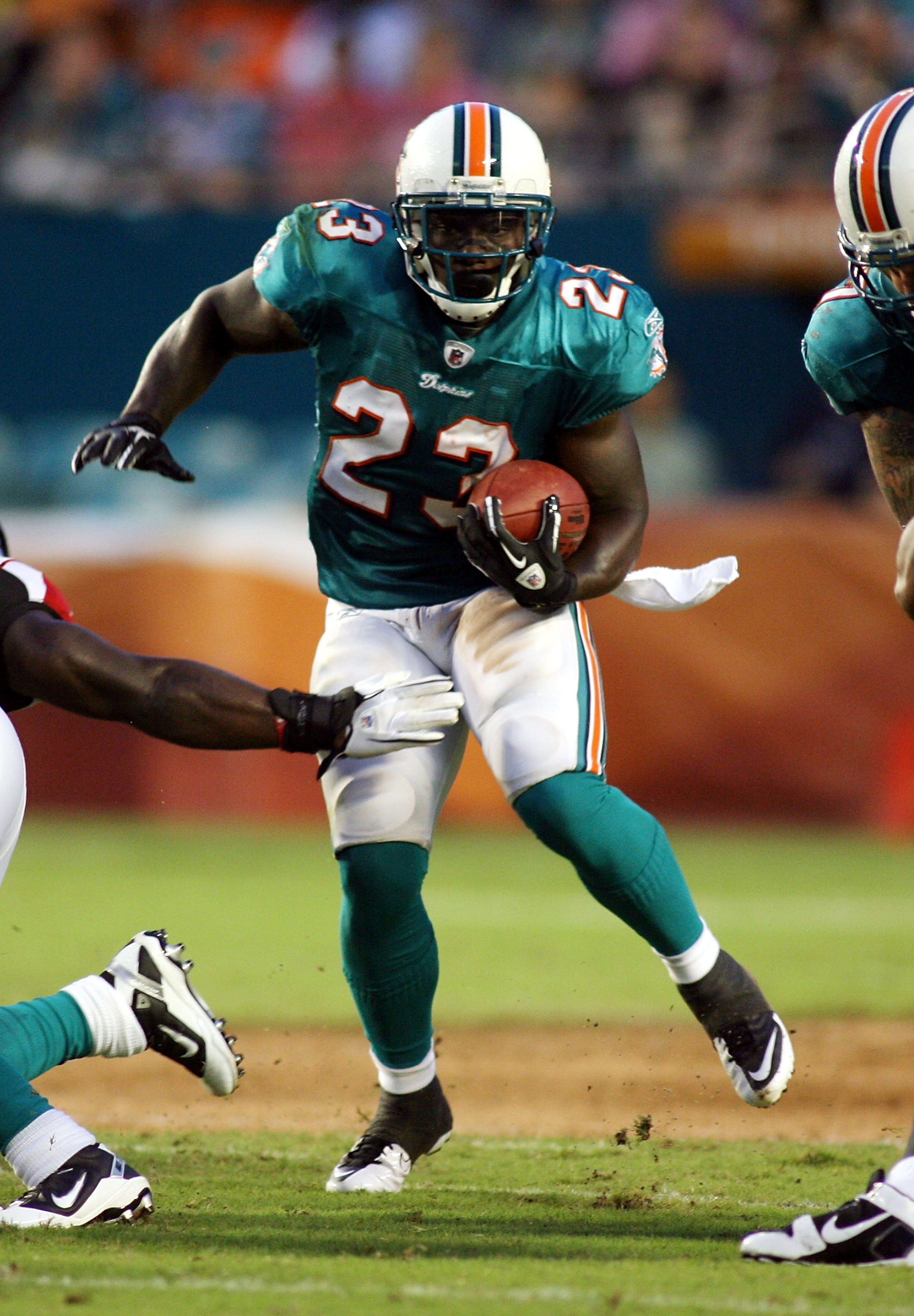 MIAMI - AUGUST 27:  Running back Ronnie Brown #23 of the Miami Dolphins rushes against the Atlanta Falcons during pre season action at Sun Life Stadium on August 27, 2010 in Miami, Florida.  (Photo by Marc Serota/Getty Images)