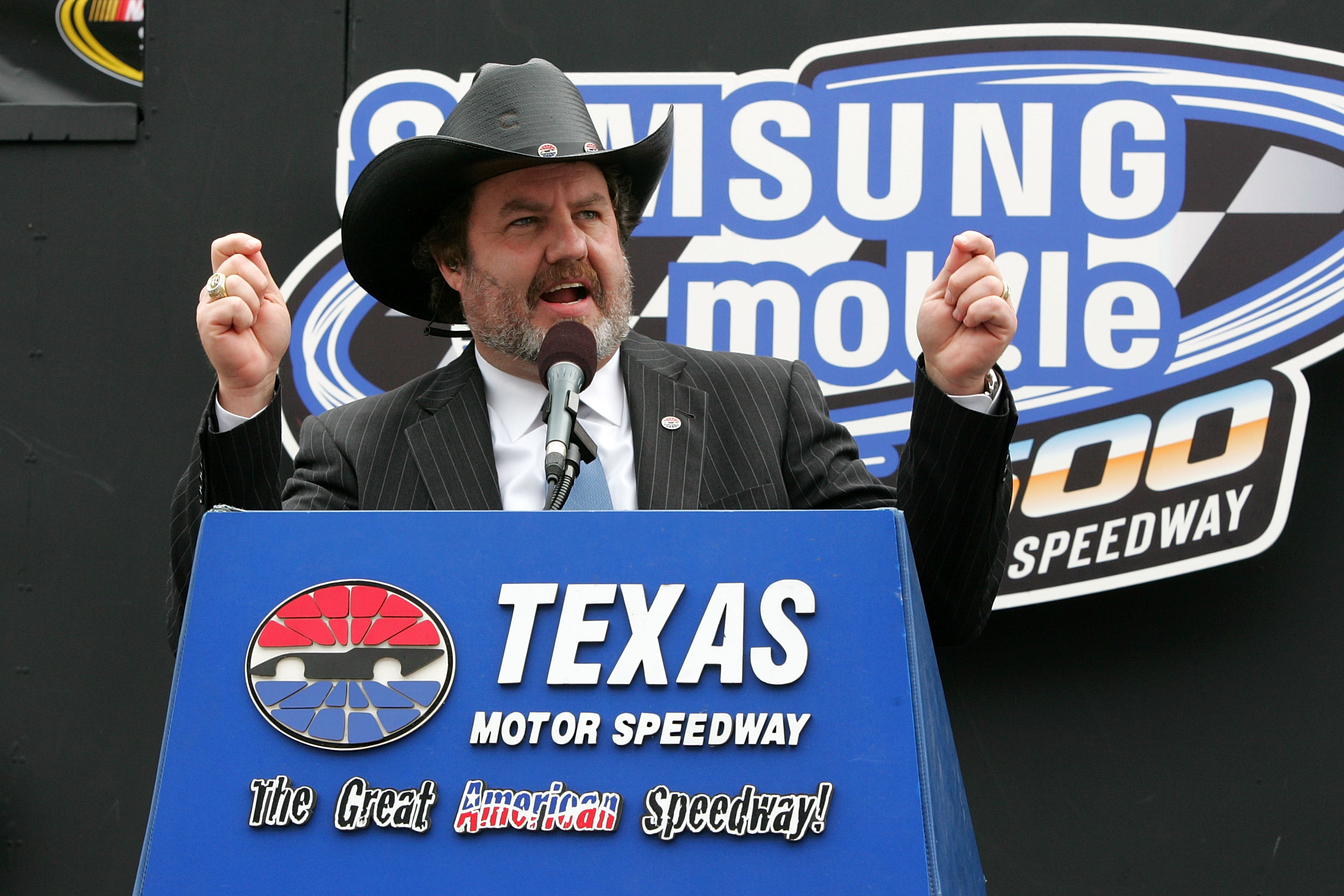 FORT WORTH, TX - APRIL 19:  President of Texas Motor Speedway Eddie Gossage addresses the fans during the NASCAR Sprint Cup Series Samsung Mobile 500 at Texas Motor Speedway on April 19, 2010 in Fort Worth, Texas.  (Photo by Jerry Markland/Getty Images fo