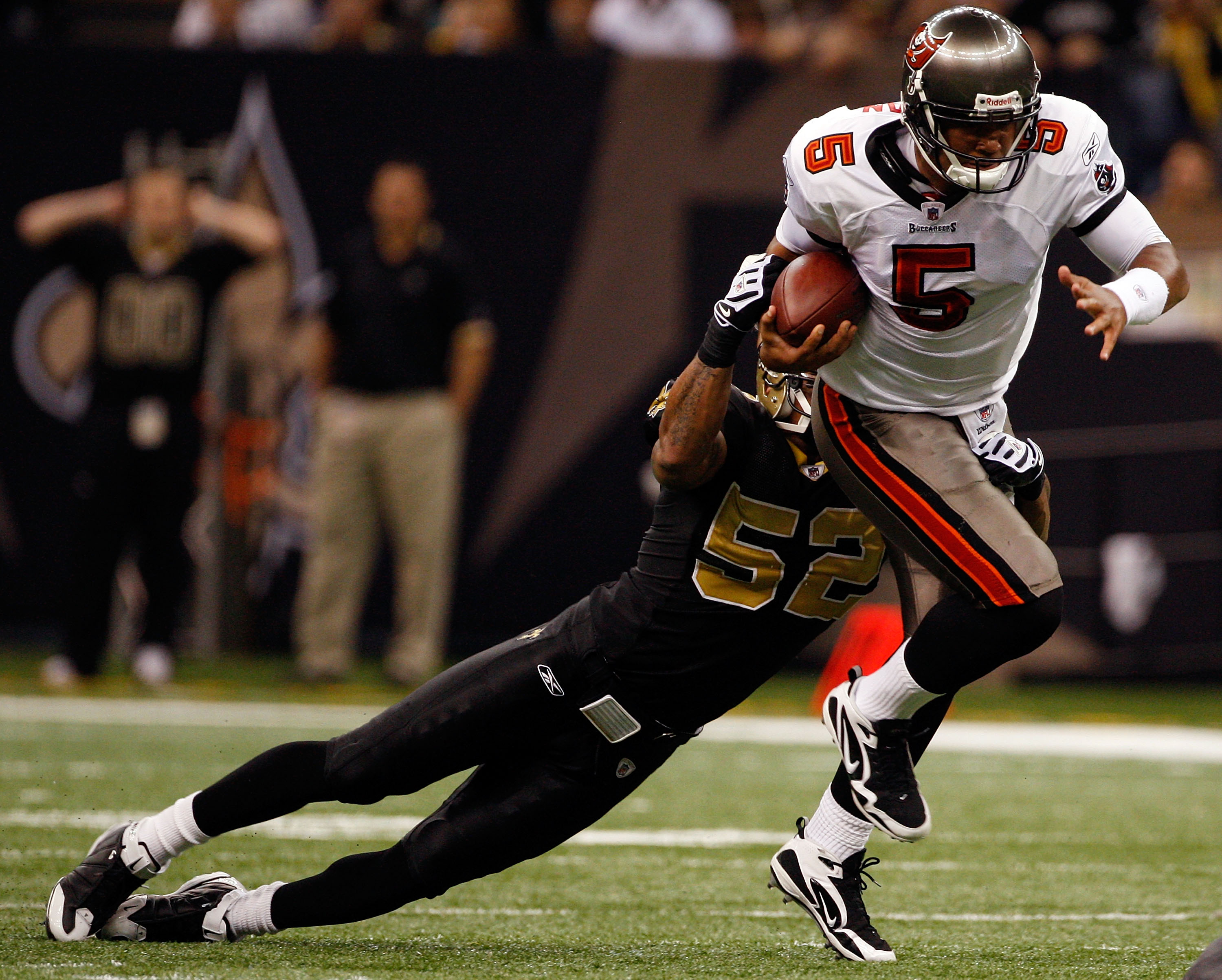 NEW ORLEANS - DECEMBER 27:  Quarterback Josh Freeman #5 of the Tampa Bay Buccaneers is sacked by Jonathan Casillas #52 of the New Orleans Saints at the Louisiana Superdome on December 27, 2009 in New Orleans, Louisiana.  (Photo by Chris Graythen/Getty Ima