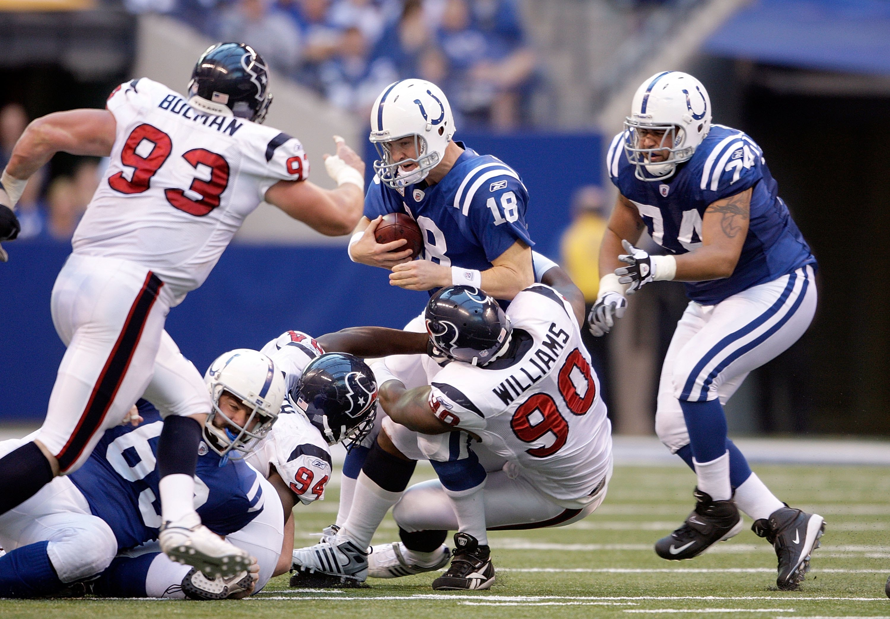 INDIANAPOLIS - NOVEMBER 8:  Peyton Manning #18 of the Indianapolis Colts is sacked by Mario Williams #90 the Houston Texans at Lucas Oil Stadium on November 8, 2009 in Indianapolis, Indiana.  The Colts defeated the Texans 20-17.  (Photo by Andy Lyons/Gett