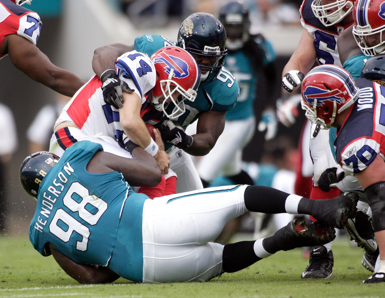JACKSONVILLE, FL - NOVEMBER 22:  Quarterback Trent Edwards #5 of the Buffalo Bills passes is sacked by defensive end John Henderson #98 of the Jacksonville Jaguars at Jacksonville Municipal Stadium on November 22, 2009 in Jacksonville, Florida.  (Photo by