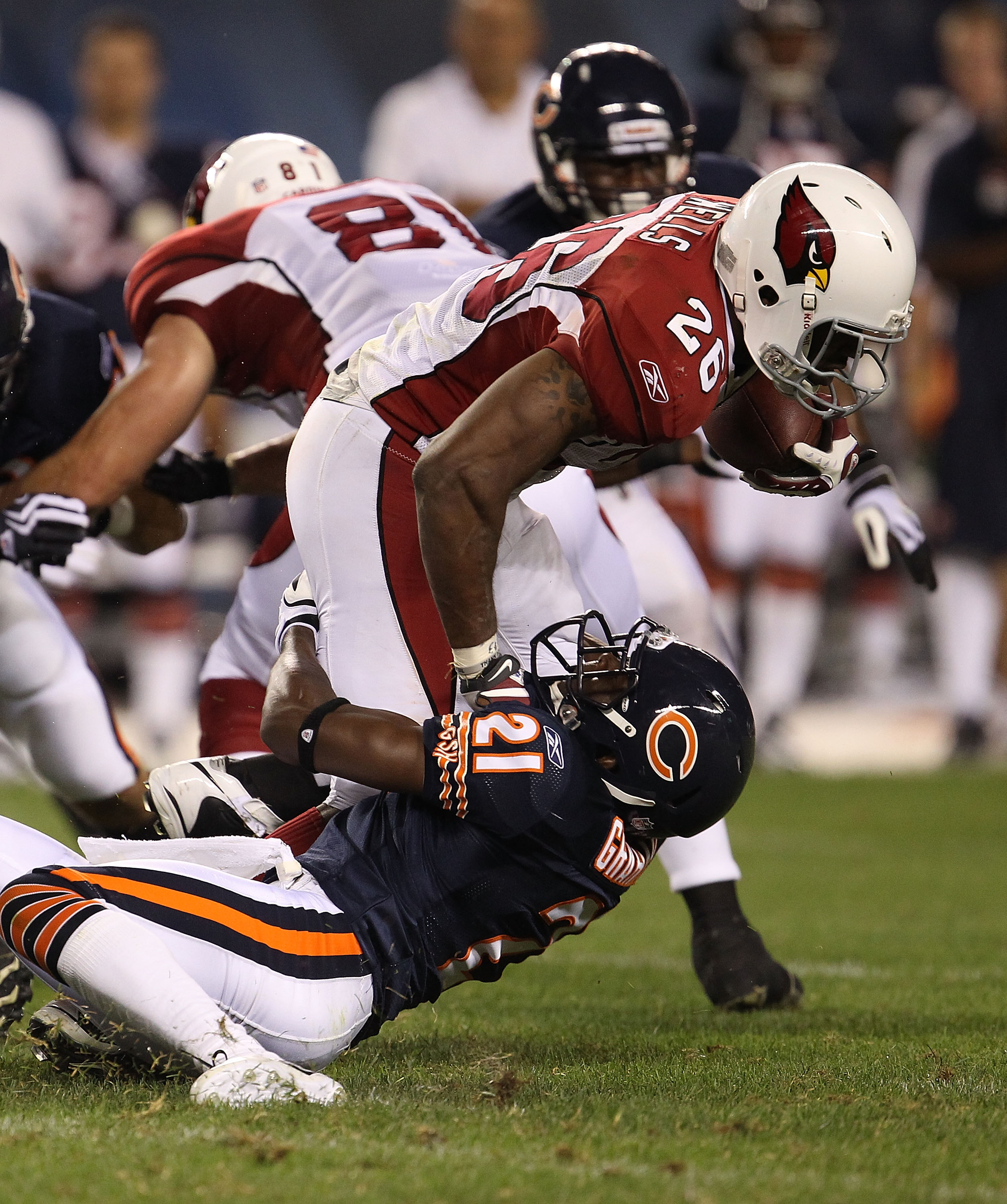 CHICAGO - AUGUST 28: Corey Graham #21 of the Chicago Bears drops Beanie Wells #26 of the Arizona Cardinals during a preseason game at Soldier Field on August 28, 2010 in Chicago, Illinois. The Cardinals defeated the Bears 14-9. (Photo by Jonathan Daniel/G
