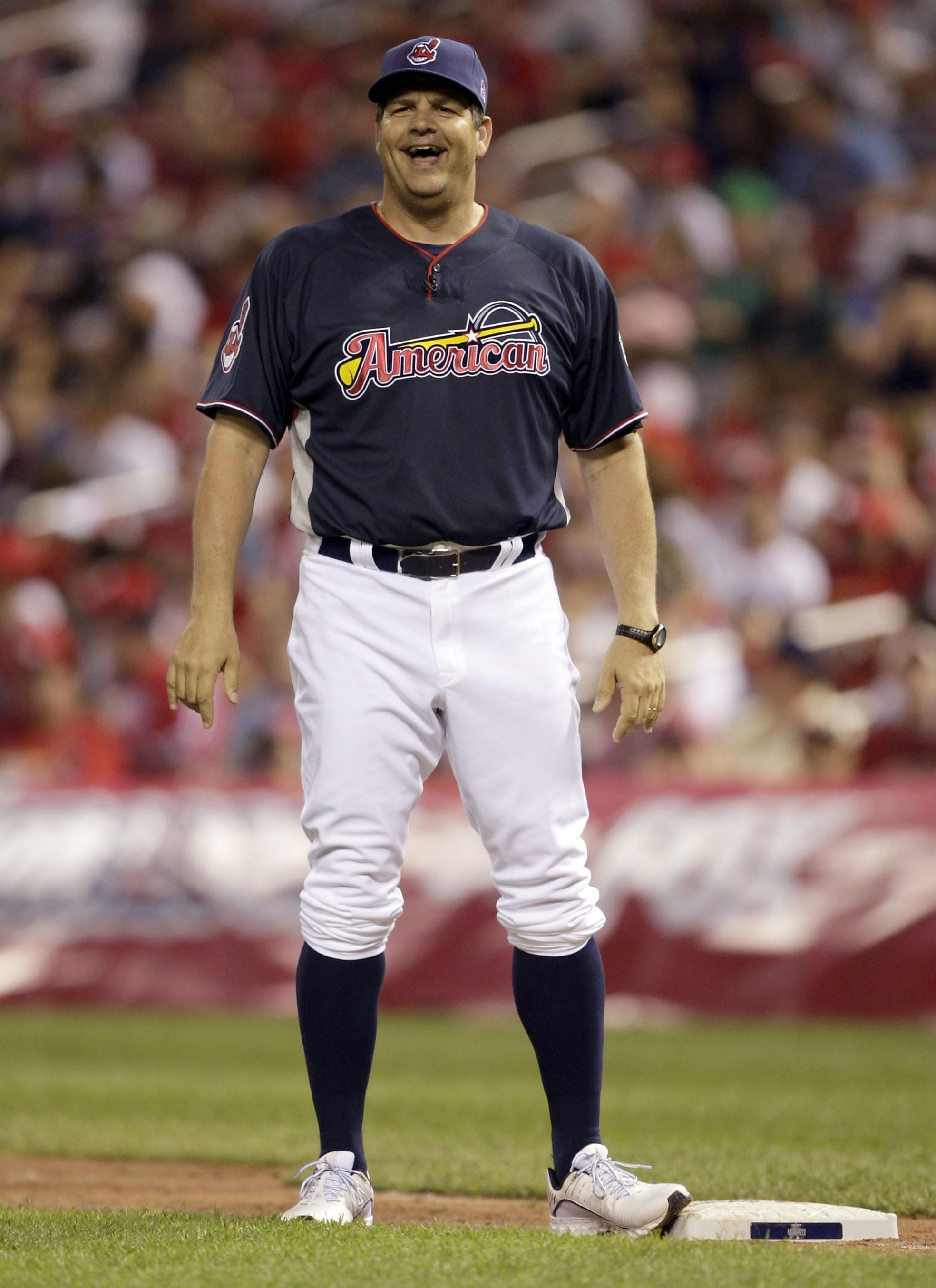 ST. LOUIS - JULY 12: TV personality Mike Golic stands on first base during the Taco Bell All-Star Legends & Celebrity Softball Game at Busch Stadium on July 12, 2009 in St. Louis, Missouri. (Photo by Jamie Squire/Getty Images)