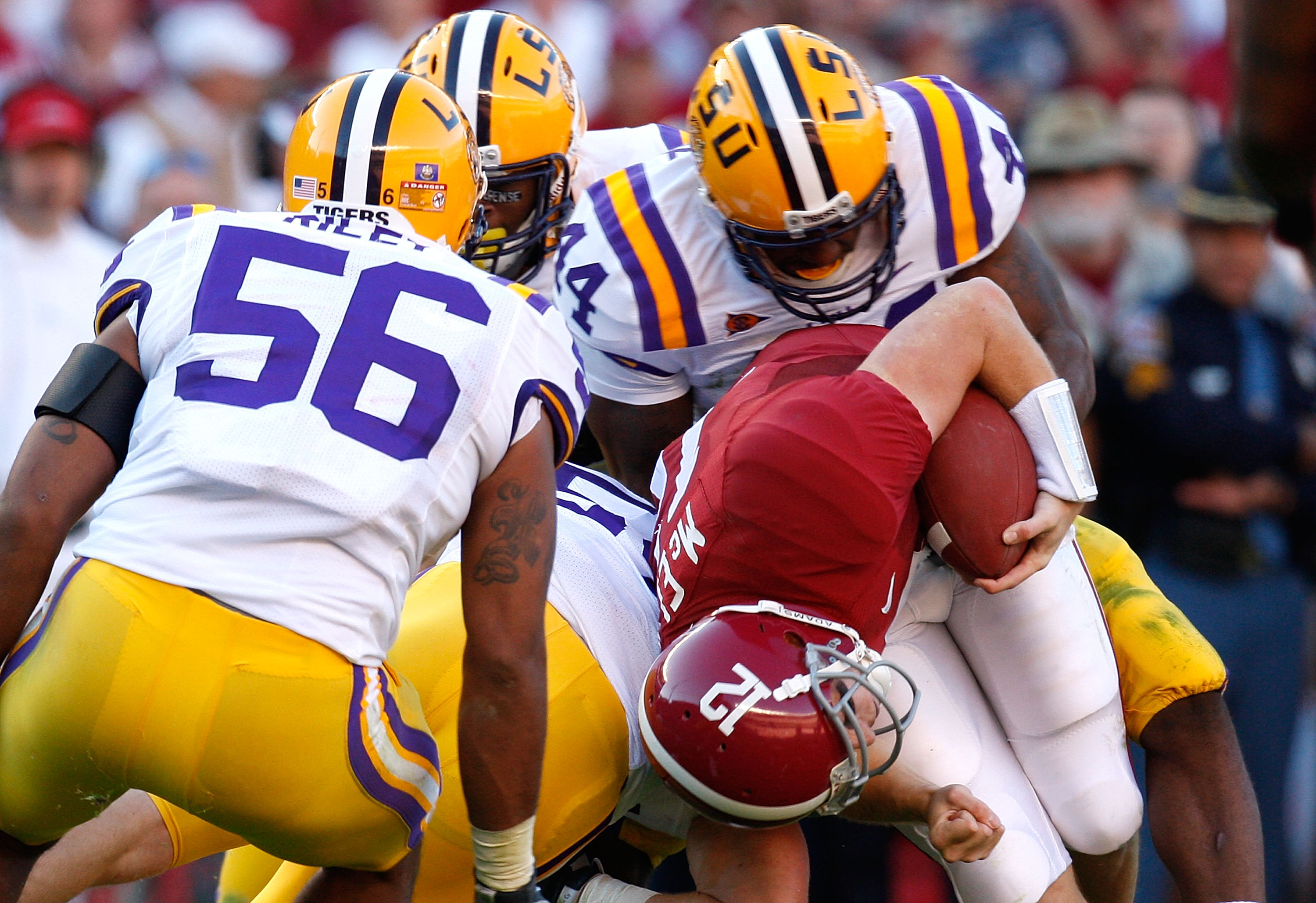 TUSCALOOSA, AL - NOVEMBER 07:  Perry Riley #56 and Danny McCray #44 of the Louisiana State University Tigers tackle quarterback Greg McElroy #12 of the Alabama Crimson Tide at Bryant-Denny Stadium on November 7, 2009 in Tuscaloosa, Alabama.  (Photo by Kev