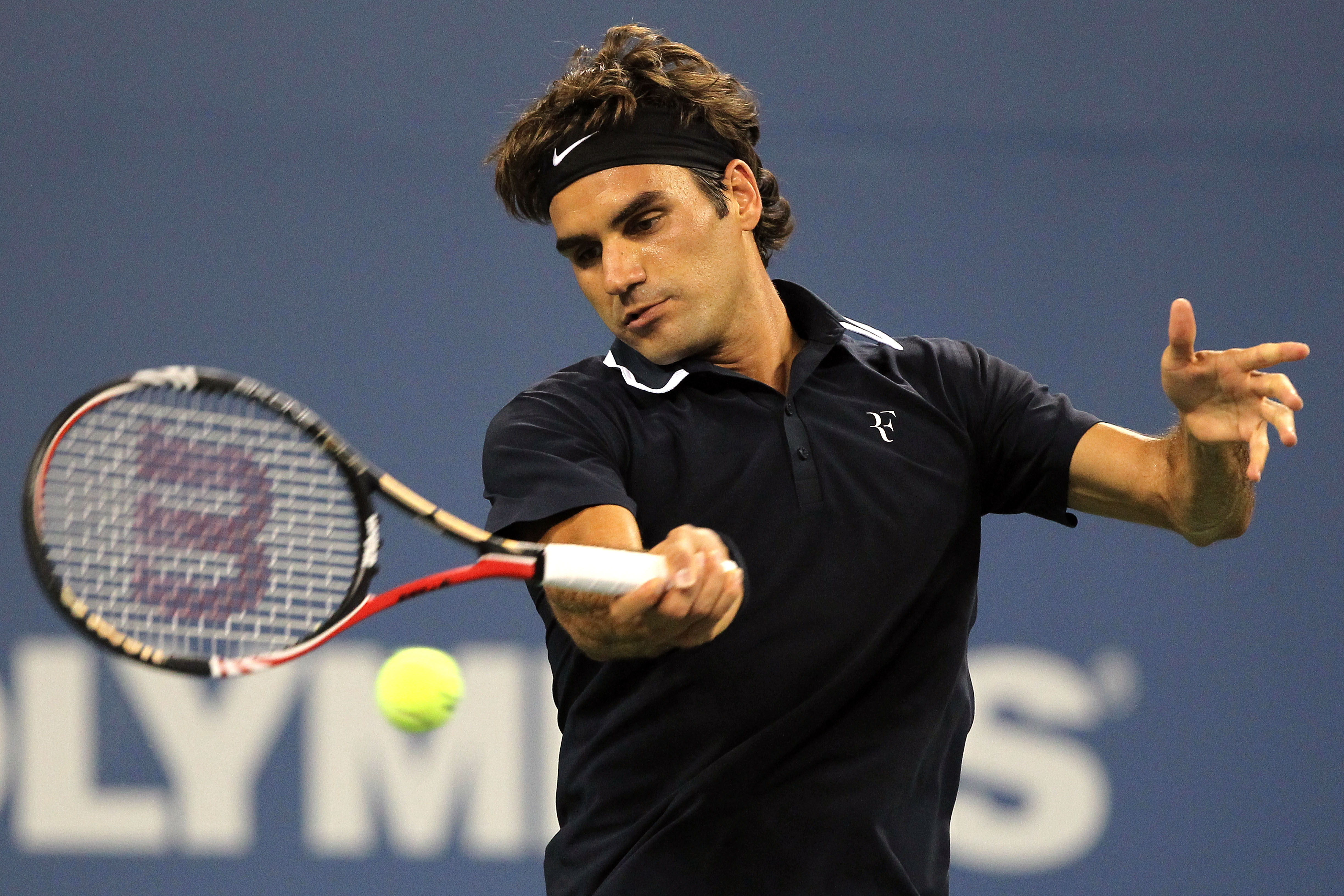 NEW YORK - AUGUST 30:  Roger Federer of Switzerland returns a forehand against Brian Dabul of Argentina during the Men's Singles first round match on day one of the 2010 U.S. Open at the USTA Billie Jean King National Tennis Center on August 30, 2010 in t