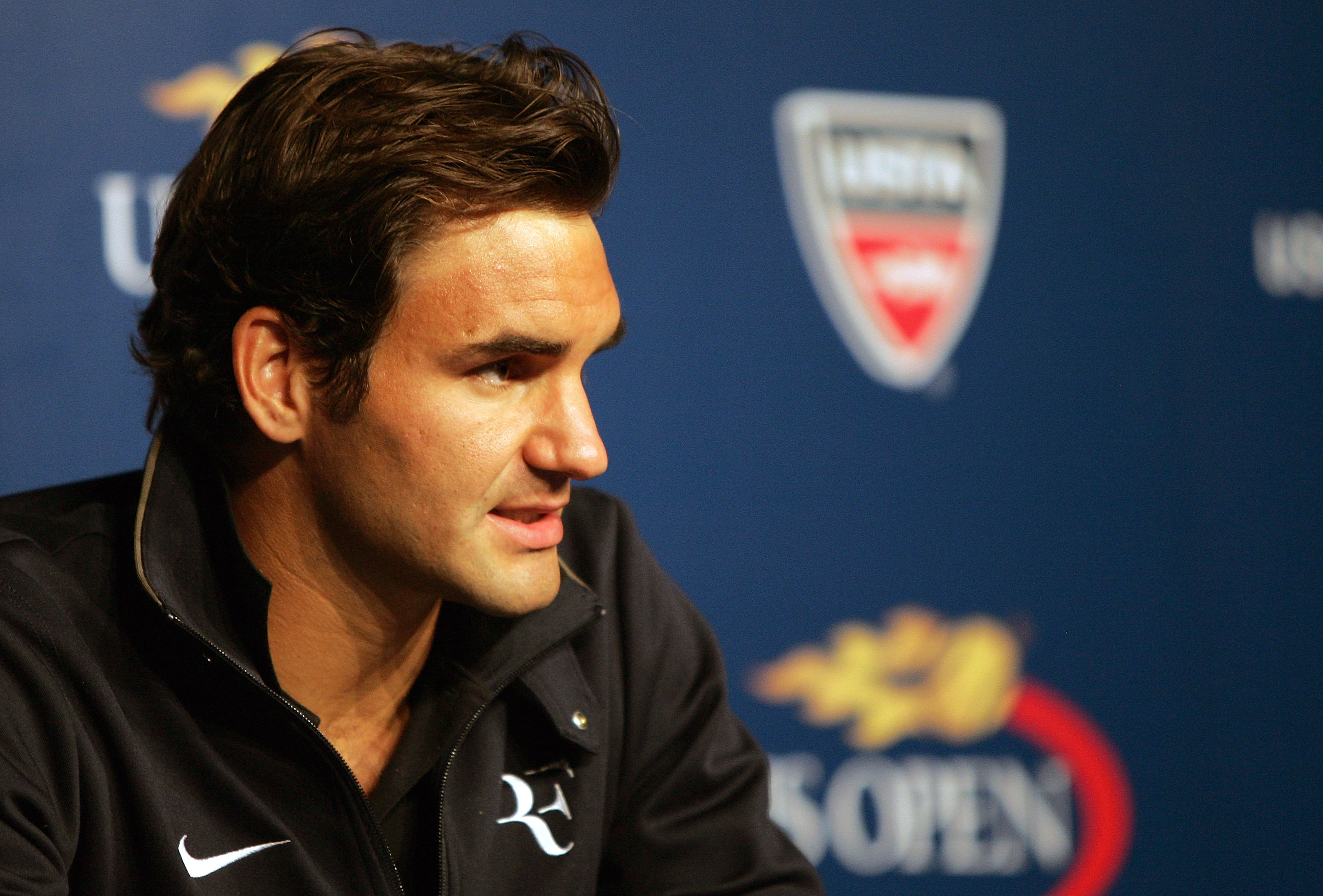 NEW YORK - AUGUST 28:  Roger Federer of Switzerland talks to the media during a press conference held on Arthur Ashe Kids' Day prior to the start of the 2010 U.S. Open at the USTA Billie Jean King National Tennis Center on August 28, 2010 in the Flushing