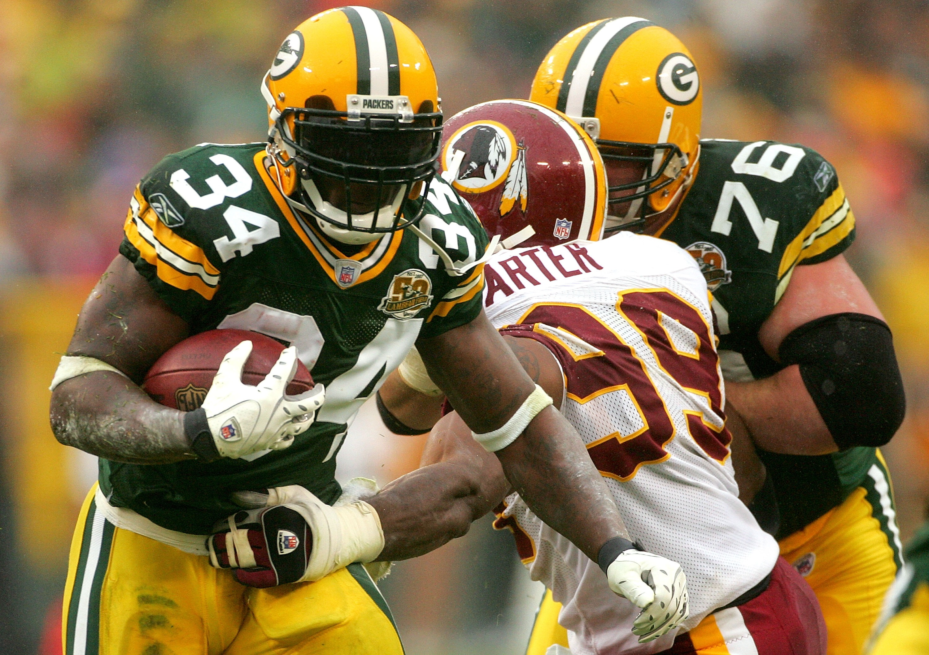 GREEN BAY, WI - OCTOBER 14:  Vernand Morency #34 of the Green Bay Packers tries to break free from Andre Carter #99 of the Washington Redskins October 14, 2007 at Lambeau Field in Green Bay, Wisconsin.  (Photo by Matthew Stockman/Getty Images)