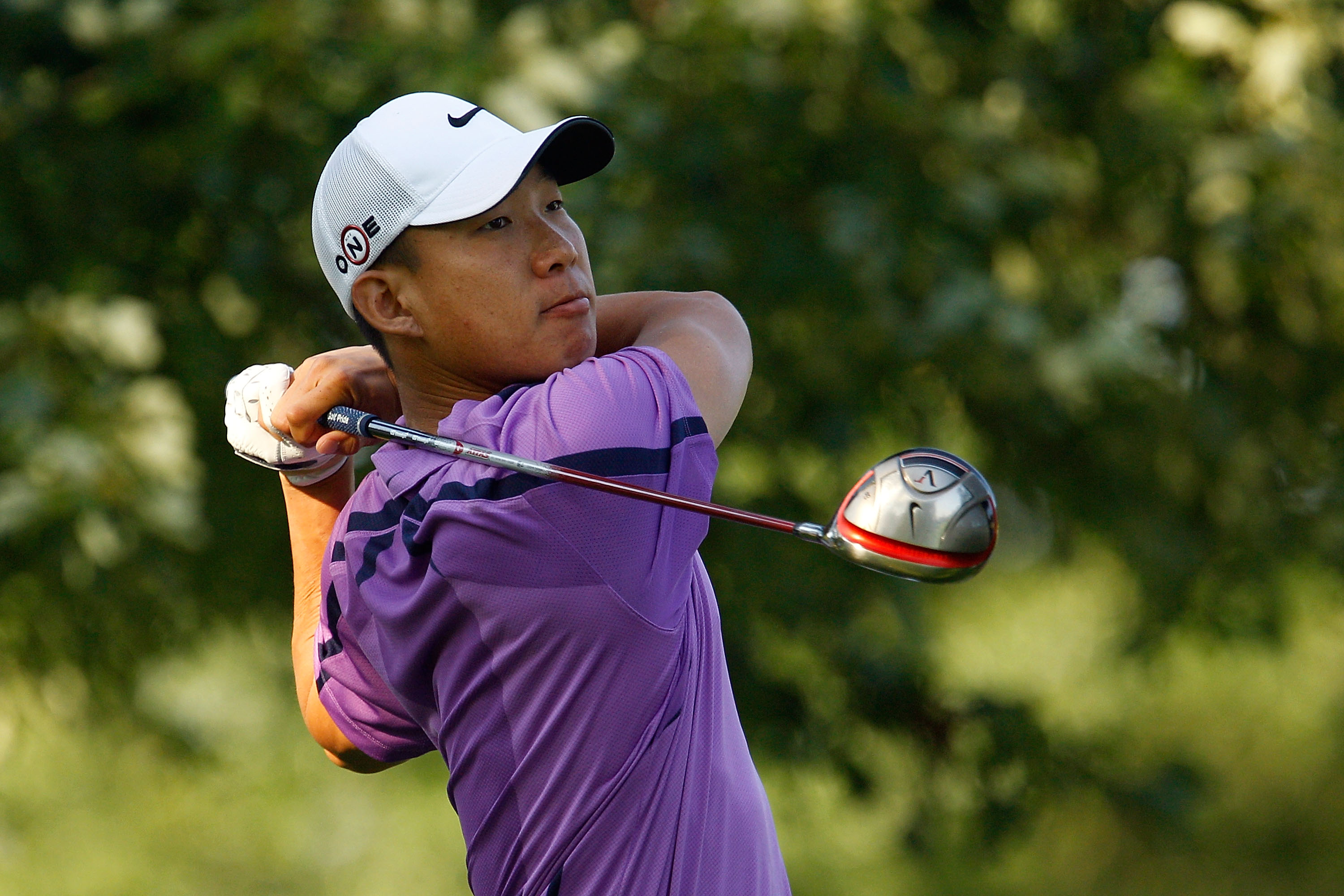 PARAMUS, NJ - AUGUST 26:  Anthony Kim watches his tee shot on the 11th hole during the first round of The Barclays at the Ridgewood Country Club on August 26, 2010 in Paramus, New Jersey.  (Photo by Scott Halleran/Getty Images)