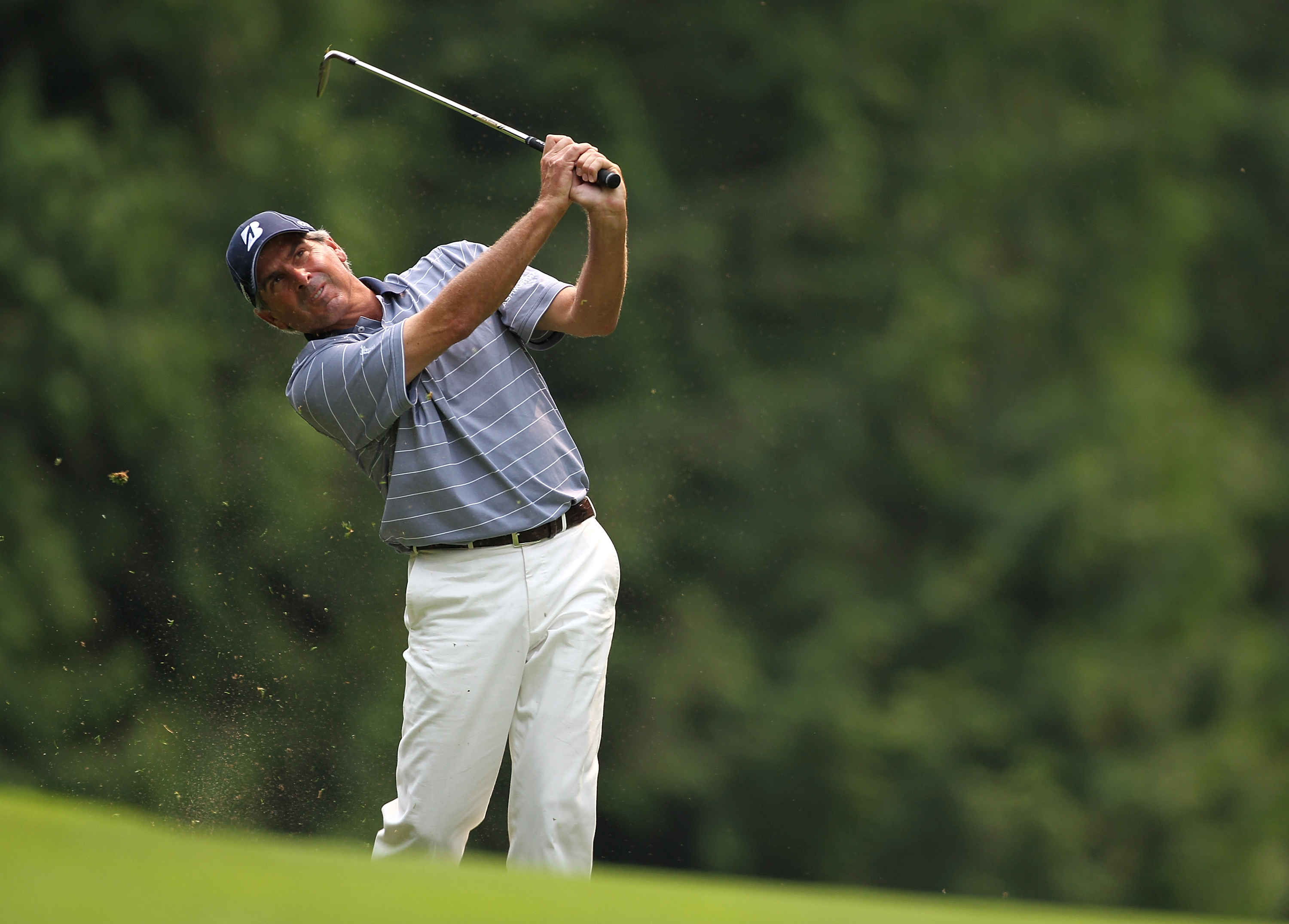 SAMMAMISH, WA - AUGUST 01:  Fred Couples hits his second shot on the 14th hole during the final round of the U.S. Senior Open Championship on August 1, 2010 at Sahalee Country Club in Sammamish, Washington..  (Photo by Jonathan Ferrey/Getty Images)