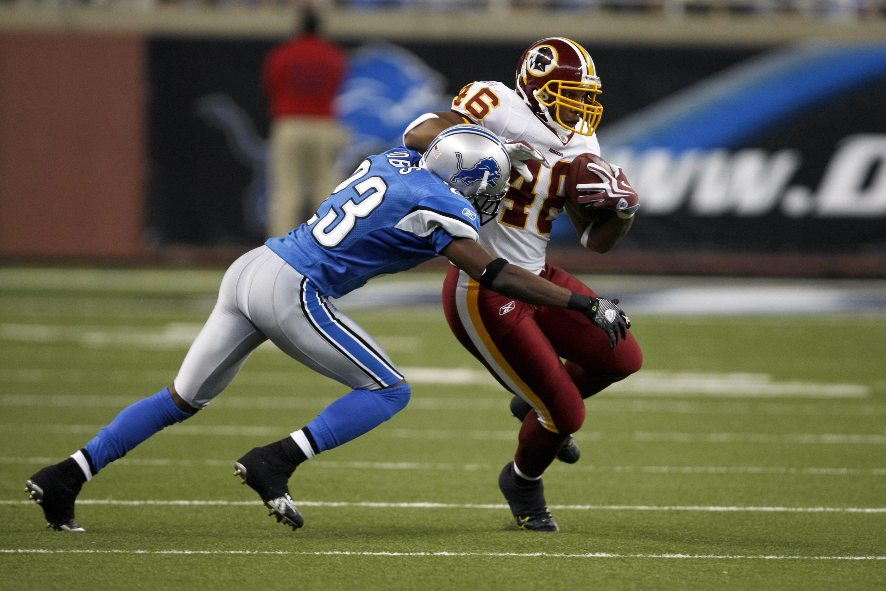 DETROIT, MI - SEPTEMBER 27: Running back Ladell Betts #46 of the Washington Redskins runs with the football as he is tackled by Kevin Hobbs #23 of the Detroit Lions at Ford Field on September 27, 2009 in Detroit, Michigan. The Lions defeated the Redskins