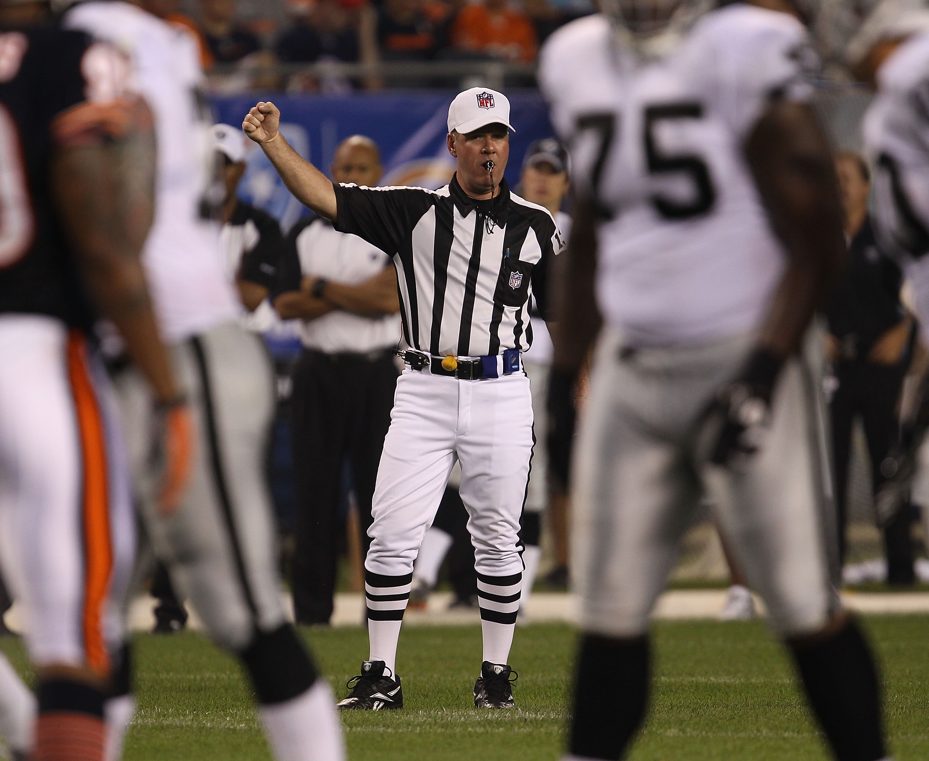 CHICAGO - AUGUST 21: Referee John Parry #132 signals for play to begin between the Chicago Bears and the Oakland Raiders during a preseason game at Soldier Field on August 21, 2010 in Chicago, Illinois. The Raiders defeated the Bears 32-17. (Photo by Jona