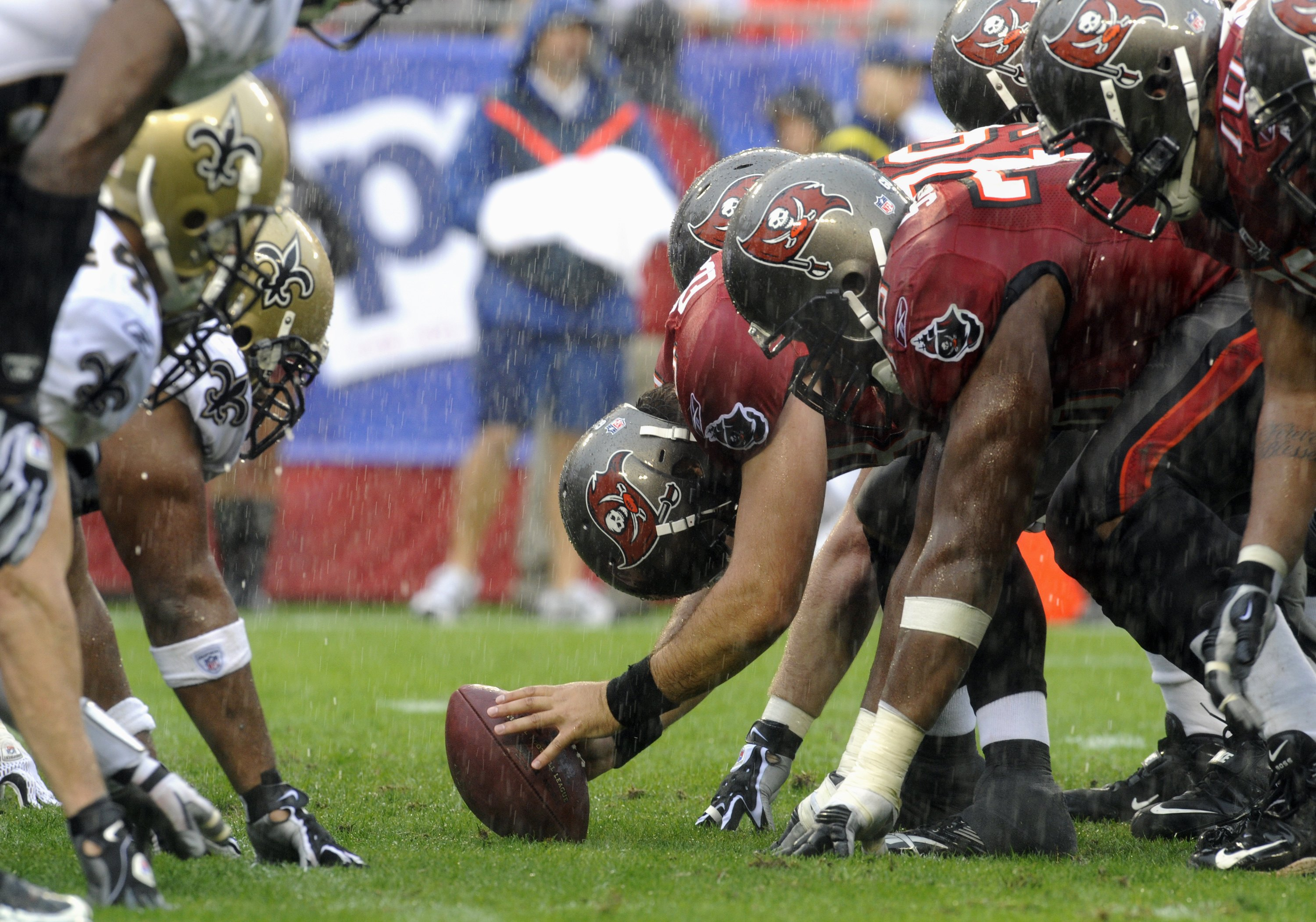 TAMPA, FL - NOVEMBER 30: Long snapper Andrew Economos #48 of the Tampa Bay Buccaneers sets for a snap in the rain against the New Orleans Saints at Raymond James Stadium on November 30, 2008 in Tampa, Florida.  (Photo by Al Messerschmidt/Getty Images)