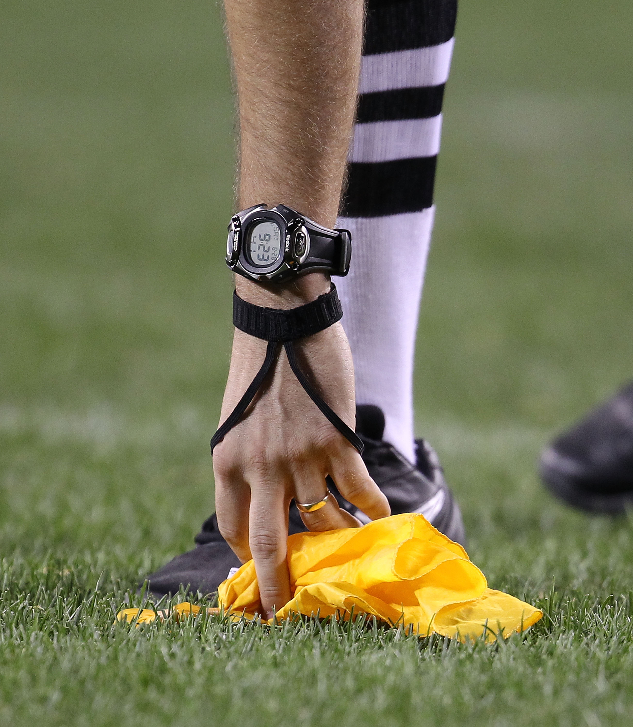 CHICAGO - AUGUST 28: A referee picks up a penalty flag during a preseason game between the Chicago Bears and the Arizona Cardinals during a preseason game at Soldier Field on August 28, 2010 in Chicago, Illinois. The Cardinals defeated the Bears 14-9. (Ph