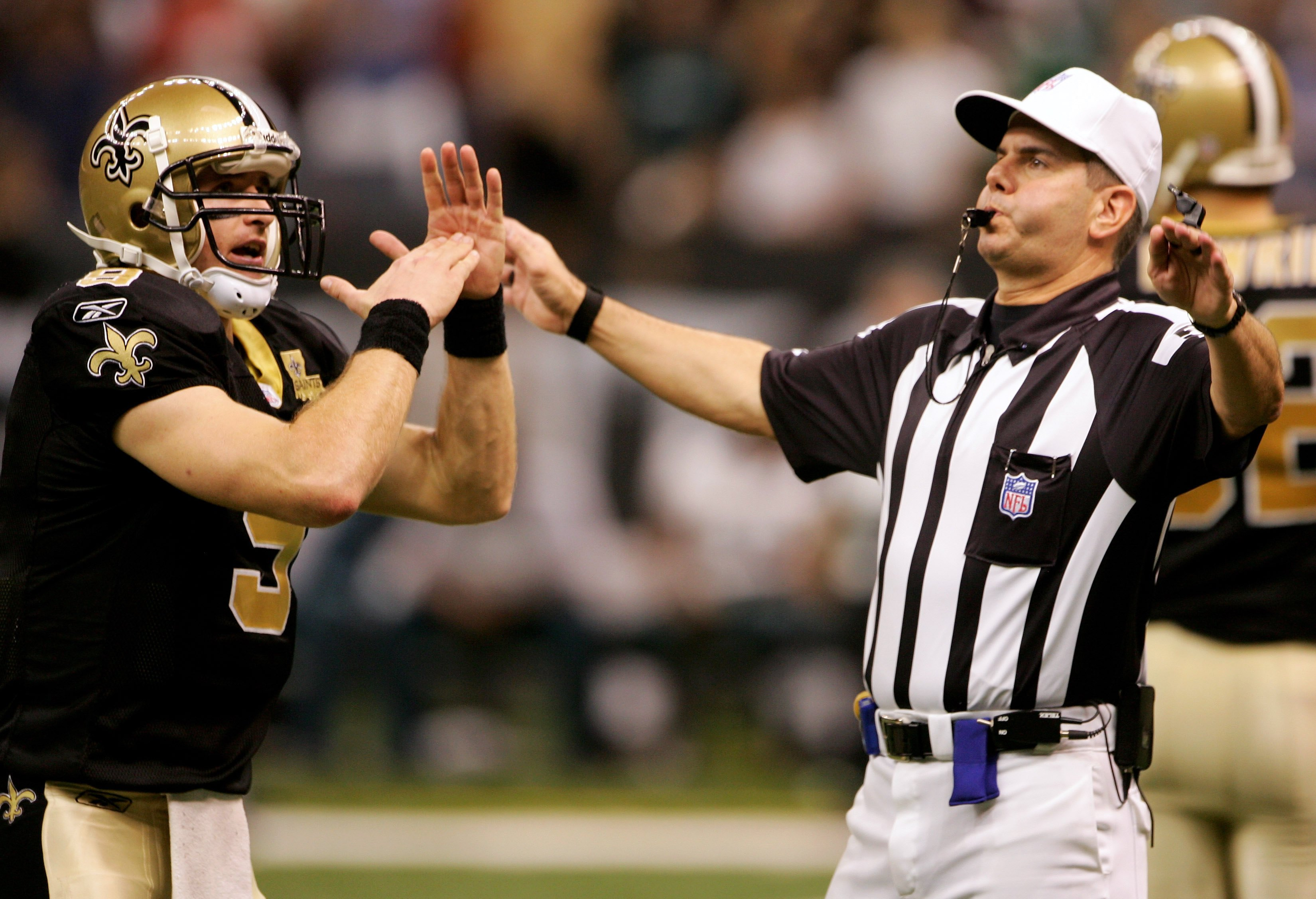 NEW ORLEANS - OCTOBER 15:  Quarterback Drew Brees #9 of the New Orleans Saints calls a time out to referee Billy Vinovich with :03 seconds on the clock before kicker John Carney #3 entered the game to kick the winning 13 yard field goal with no time remai