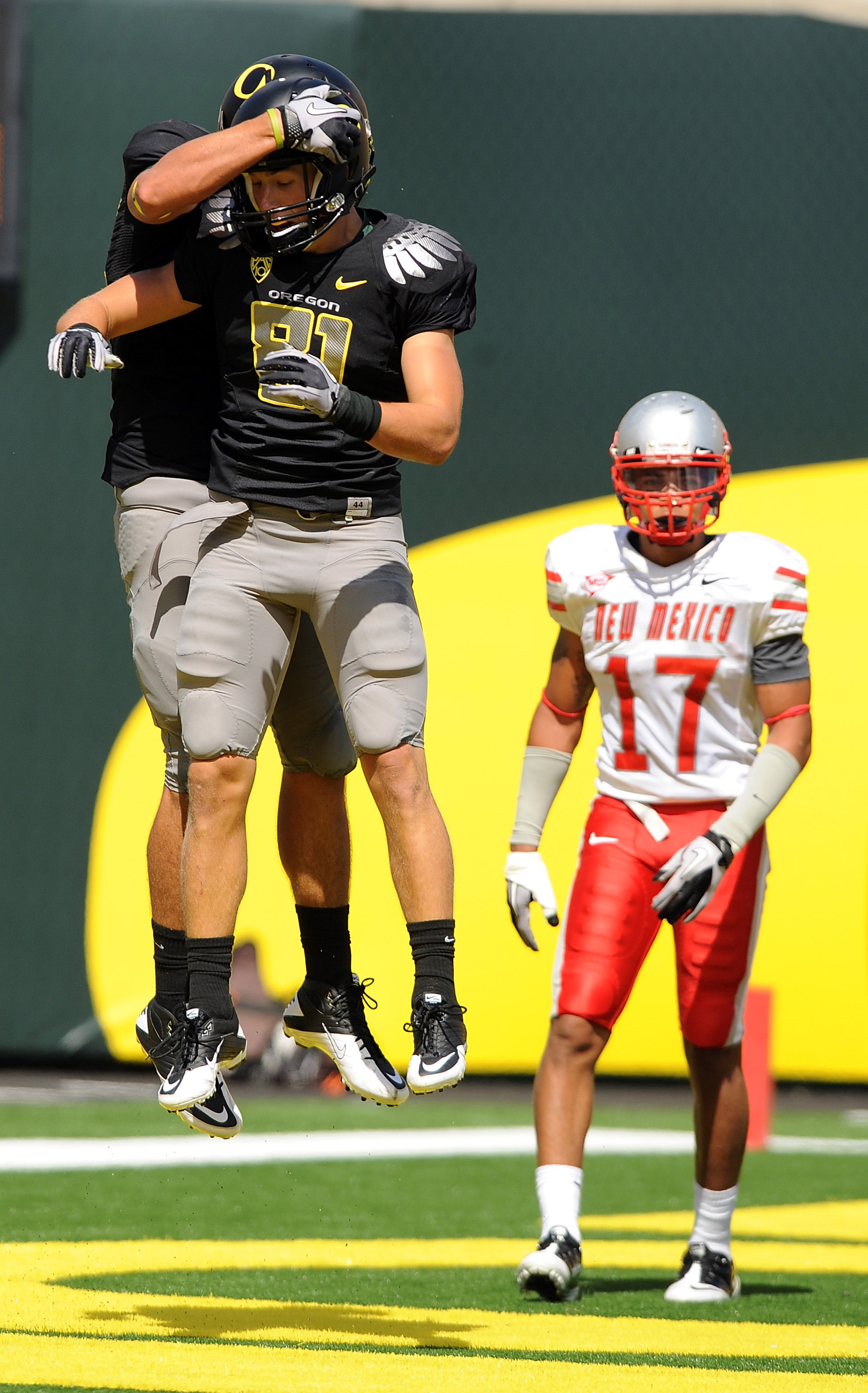EUGENE, OR - SEPTEMBER 04: Wide receiver Justin Hoffman #81 and tight end David Paulson #42 of the Oregon Ducks celebrate a touchdown reception by Paulson in front of safety Freddy Young #17 of the New Mexico Lobos in the first quarter of the game at Autz