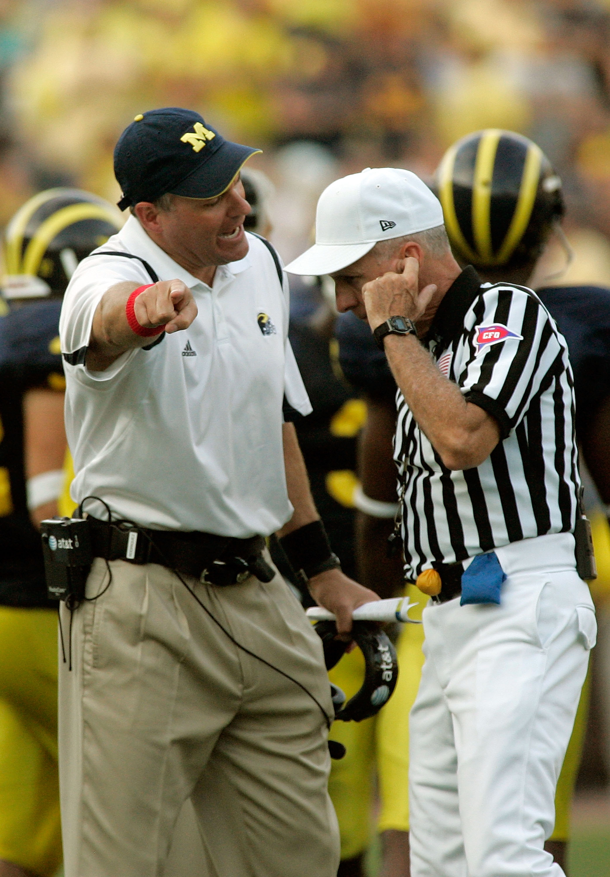 ANN ARBOR, MI - SEPTEMBER 12:  Michigan head coach Rich Rodriguez argues a call with an official in the second half against Notre Dame at Michigan Stadium on September 12, 2009 in Ann Arbor, Michigan.  (Photo by Domenic Centofanti/Getty Images)