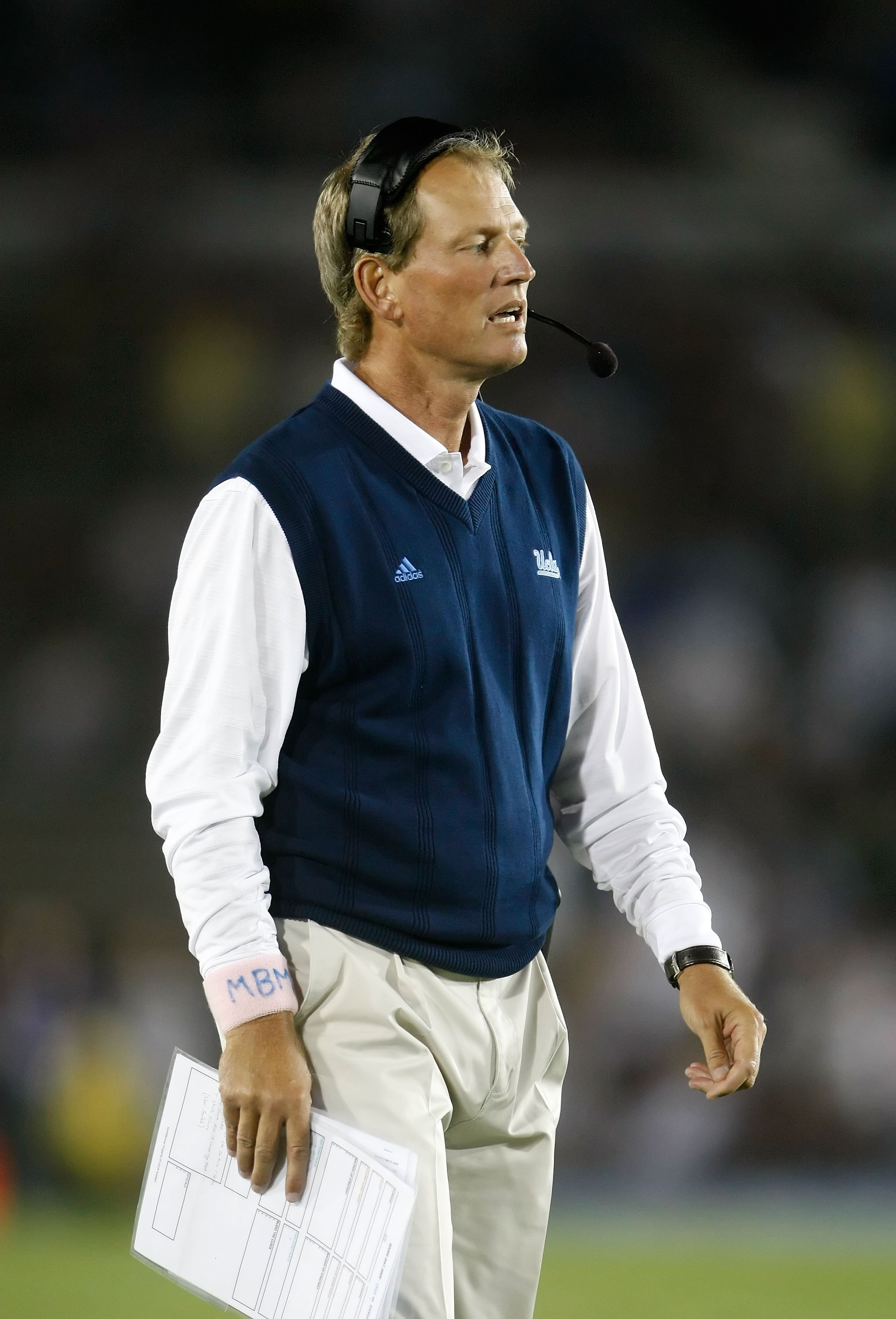 PASADENA, CA - SEPTEMBER 19:  UCLA Bruins head coach Rick Neuheisel looks on from the sideline against the Kansas State Wildcats at the Rose Bowl on September 19, 2009 in Pasadena, California. UCLA defeated Kansas State 23-9.  (Photo by Jeff Gross/Getty I
