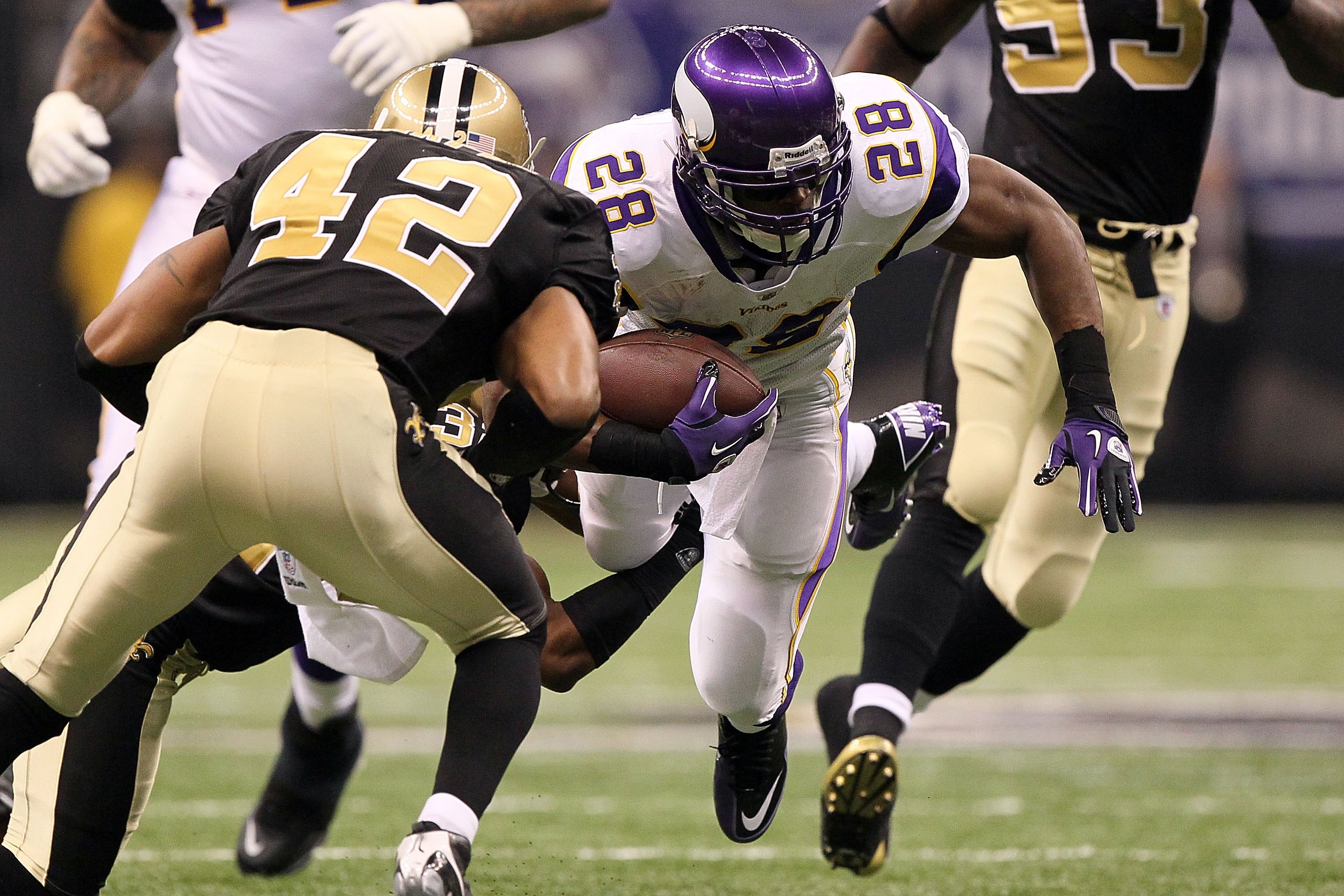 NEW ORLEANS - JANUARY 24:  Adrian Peterson #28 of the Minnesota Vikings runs the ball against the New Orleans Saints during the NFC Championship Game at the Louisiana Superdome on January 24, 2010 in New Orleans, Louisiana.  (Photo by Jed Jacobsohn/Getty